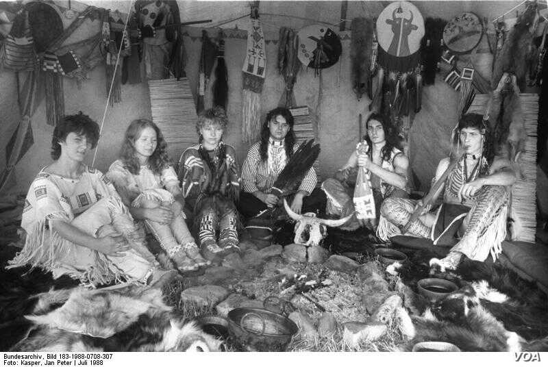 """A group of citizens of former Czechoslovakia portraying Native Americans at an """"Indianistik"""" meeting in 1988. Indian hobbyism--the desire to dress or live like traditional Native Americans--has always been popular in Eastern Europe."""