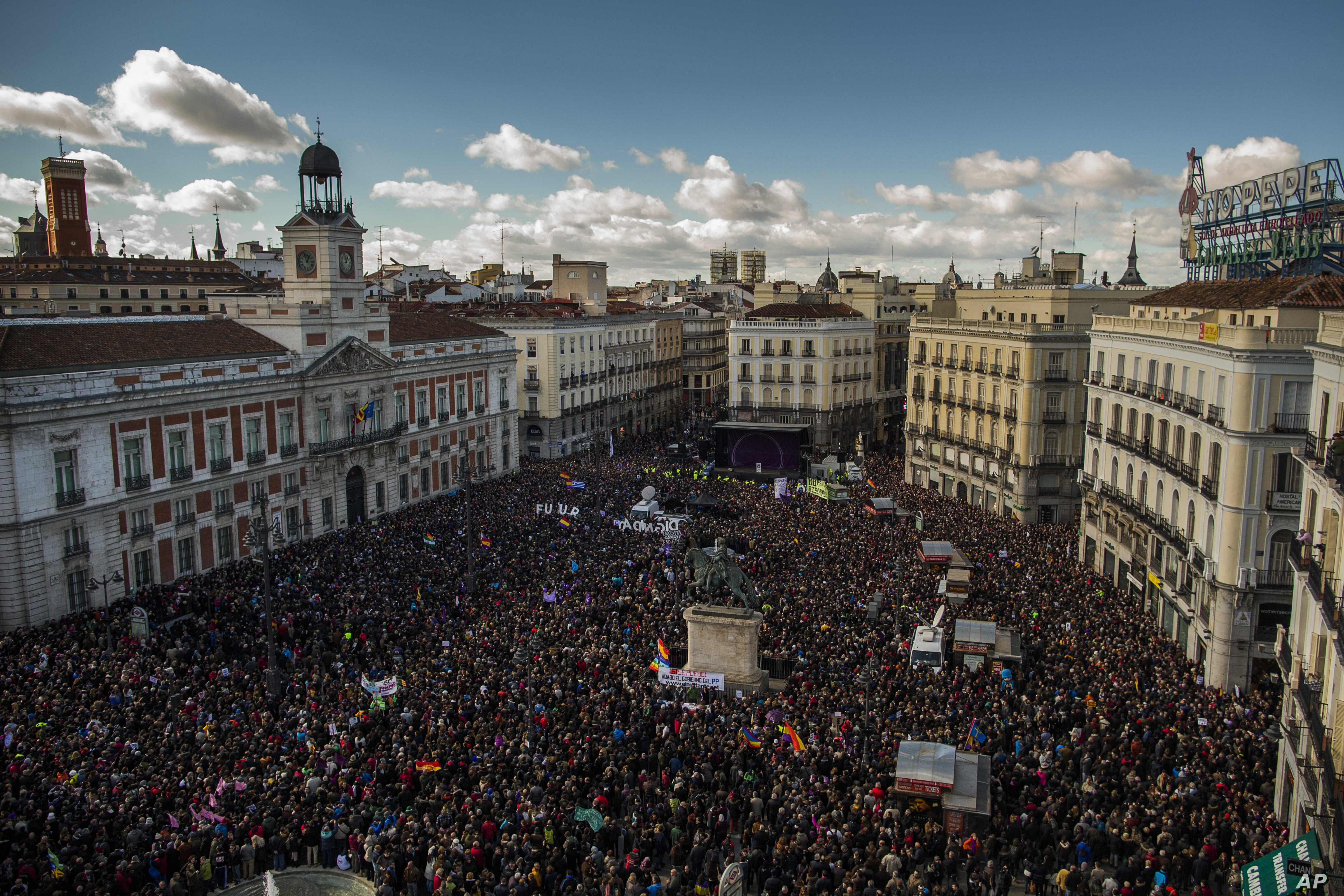 People fill the main square of Madrid during a march by members of the Podemos party, which hopes to emulate the electoral success of Greece's Syriza party in elections later this year, Jan. 31, 2015.