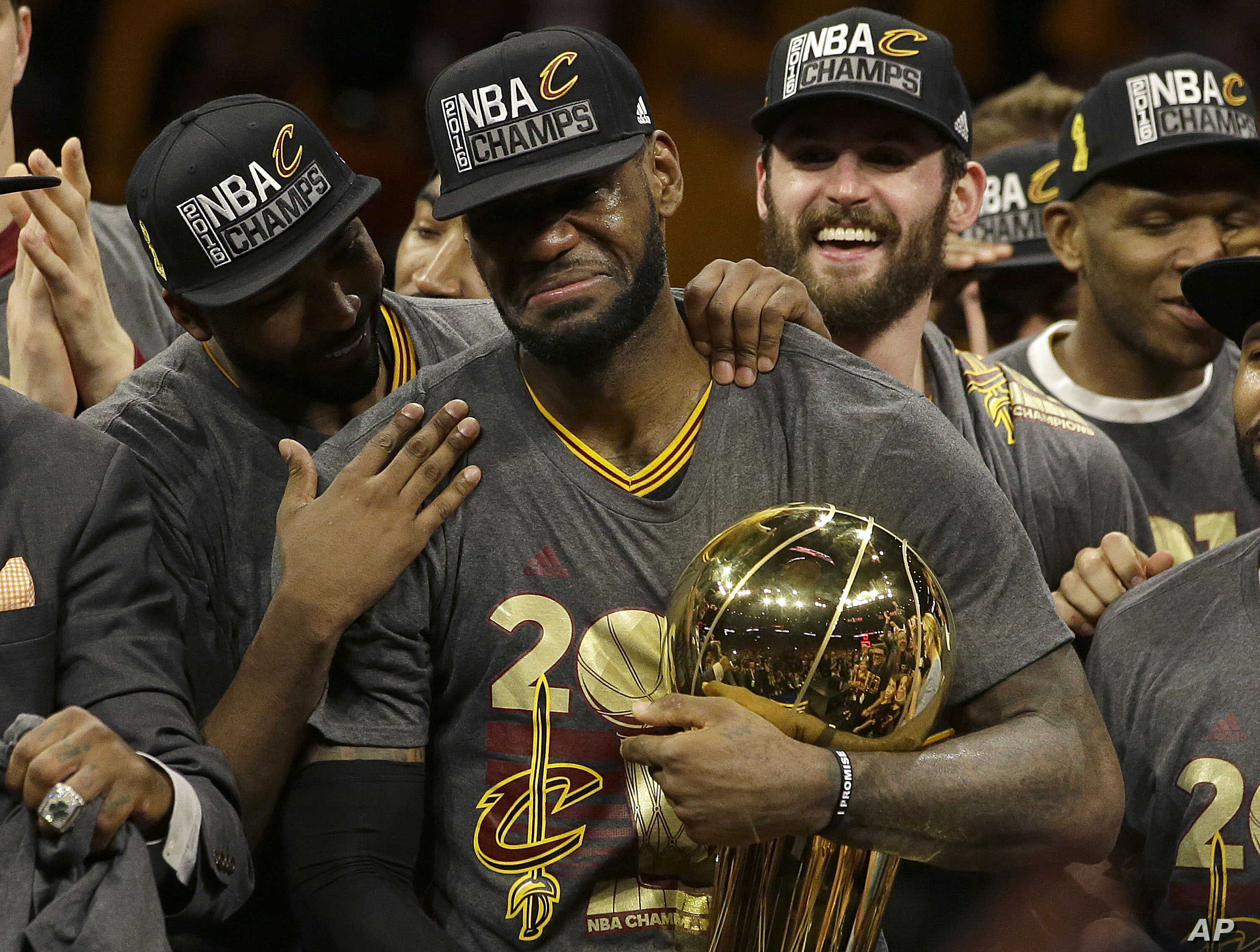 edb609e005304e Cleveland Cavaliers forward LeBron James, center, celebrates with teammates  after Game 7 of basketball's NBA Finals against the Golden State Warriors  in ...