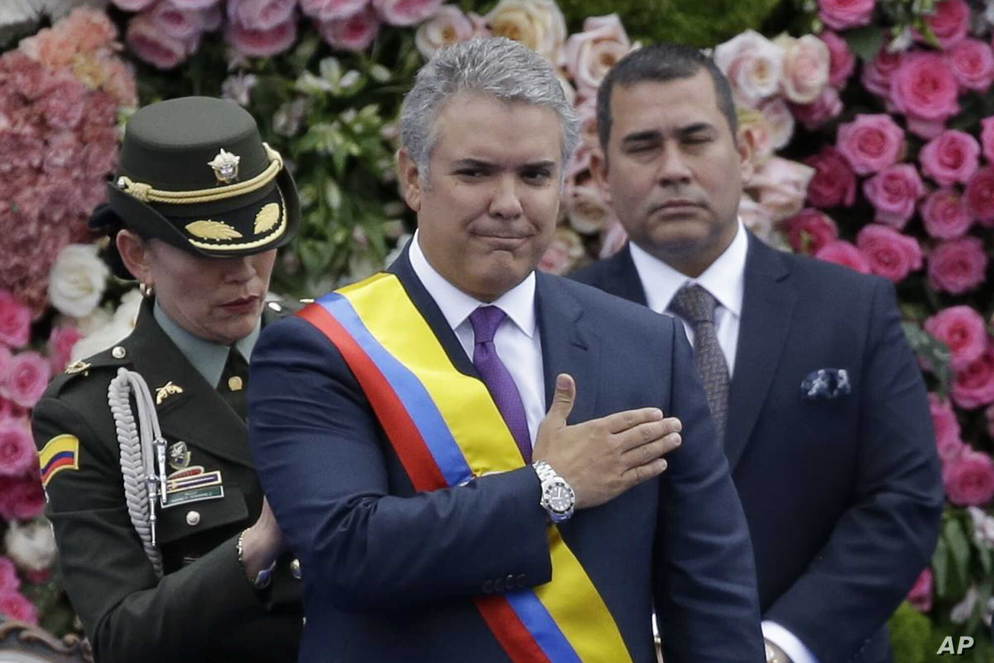 Colombia's President Ivan Duque gestures after receiving the presidential sash during his inauguration ceremony in Bogota, Colombia, Aug. 7, 2018.