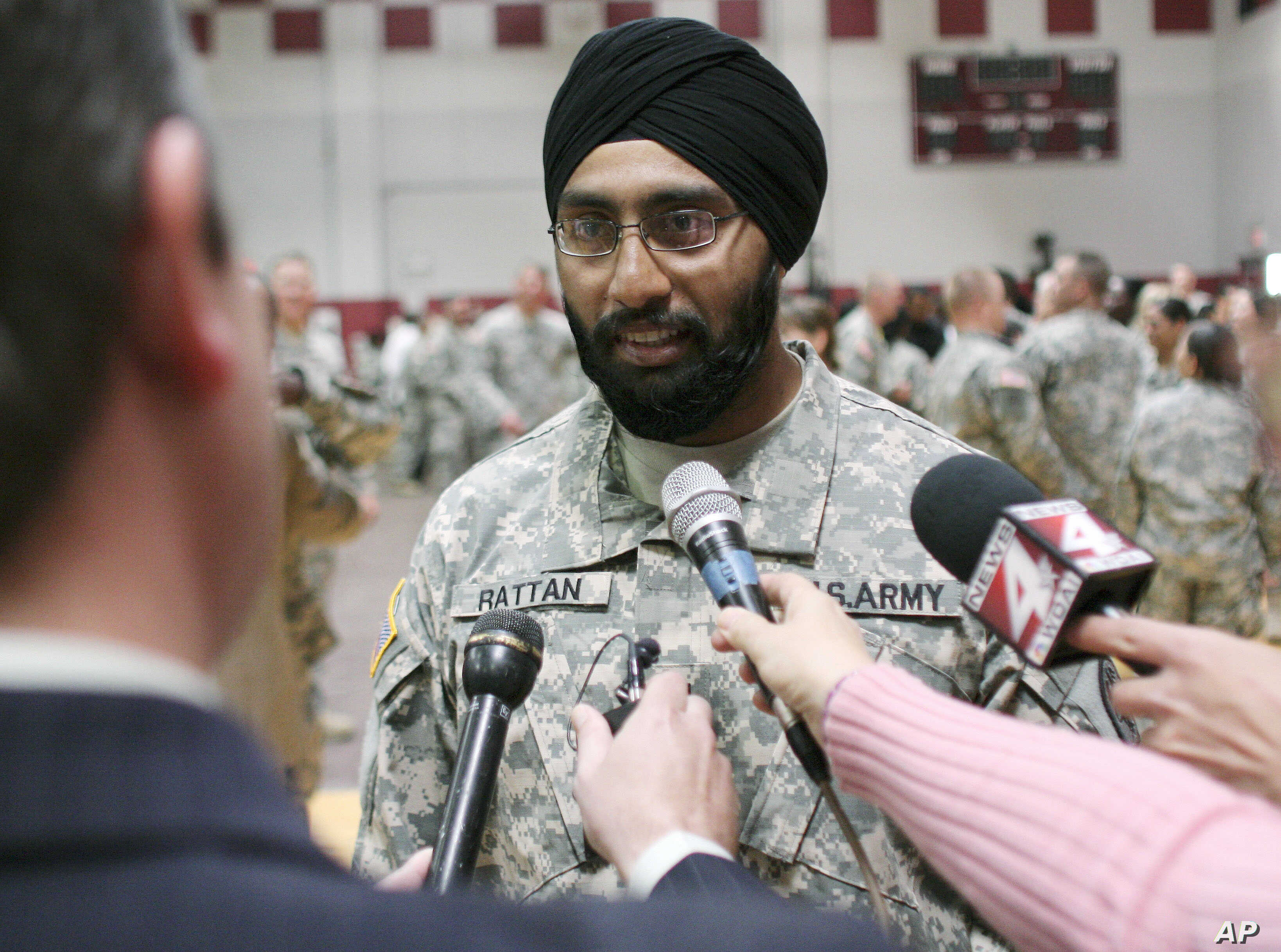 FILE - U.S. Army Capt. Tejdeep Singh Rattan speaks to journalists at a U.S. Army officer basic training graduation ceremony at Fort Sam Houston in San Antonio, March 22, 2010. Rattan was the first Sikh allowed to complete officer basic training while...