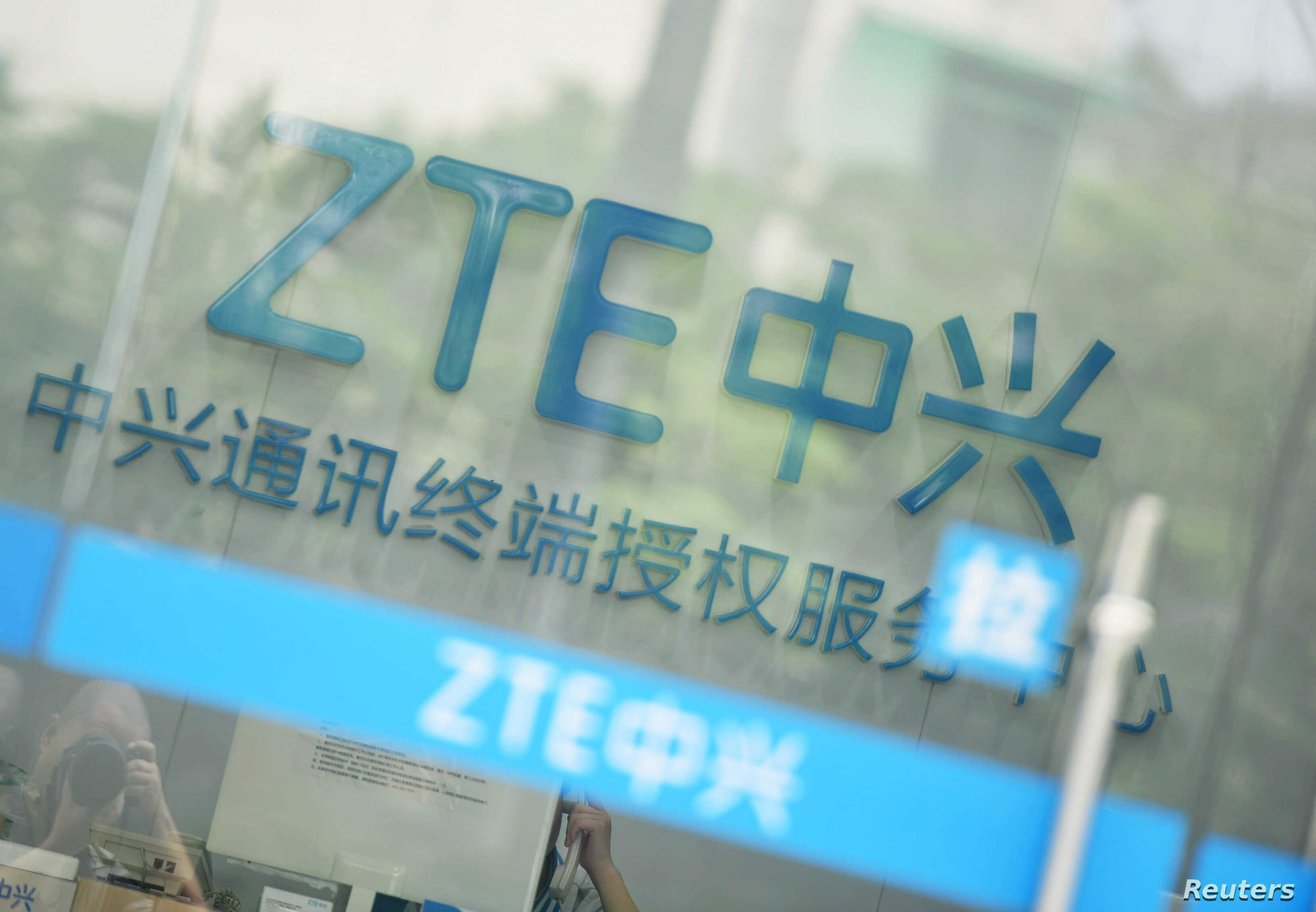 A sign of ZTE Corp is pictured at its service center in Hangzhou, Zhejiang province, China, May 14, 2018.