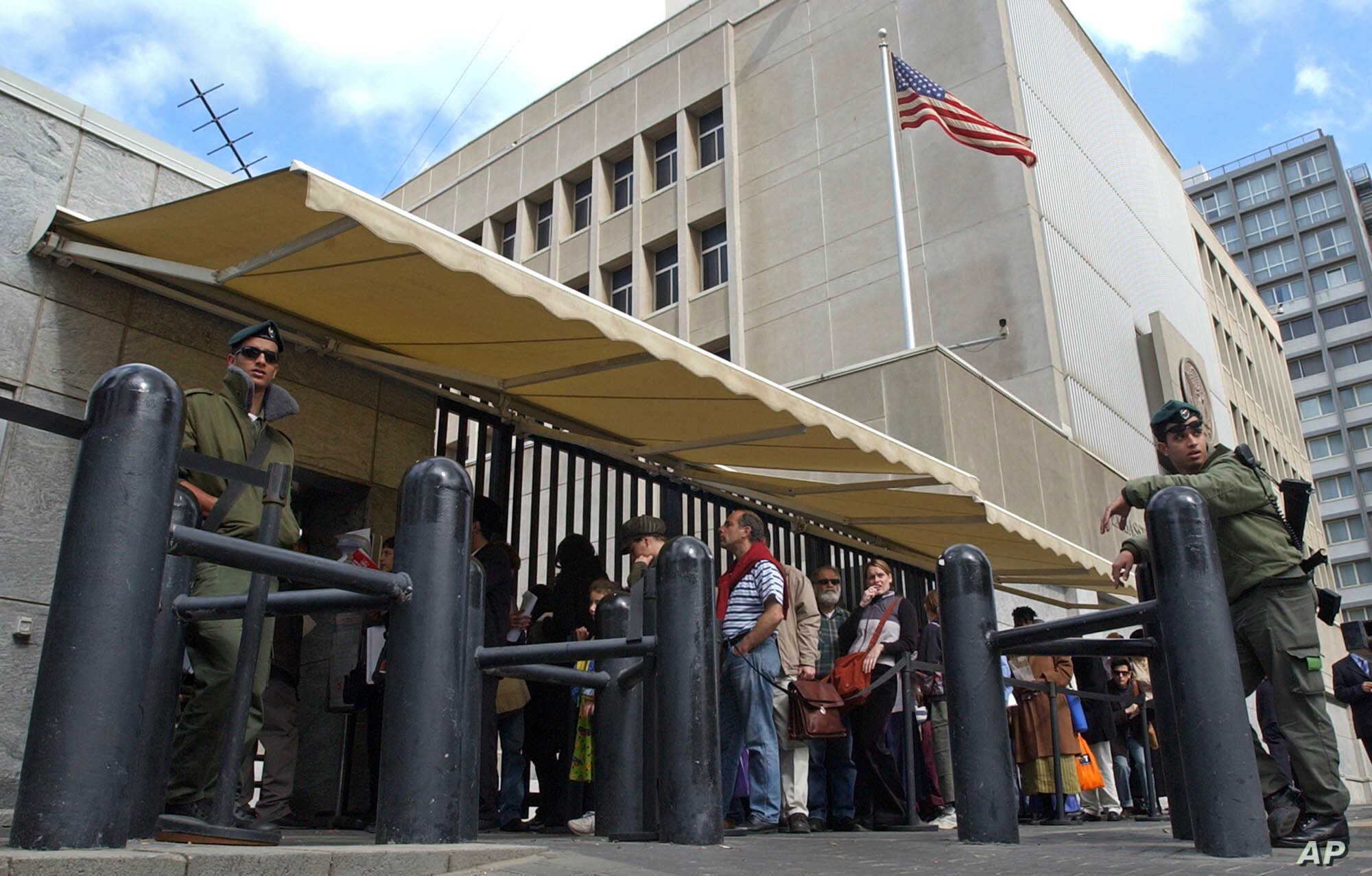 FILE - In this March 17, 2003 file photo, an Israeli border policemen guards the U.S. Embassy in Tel Aviv.