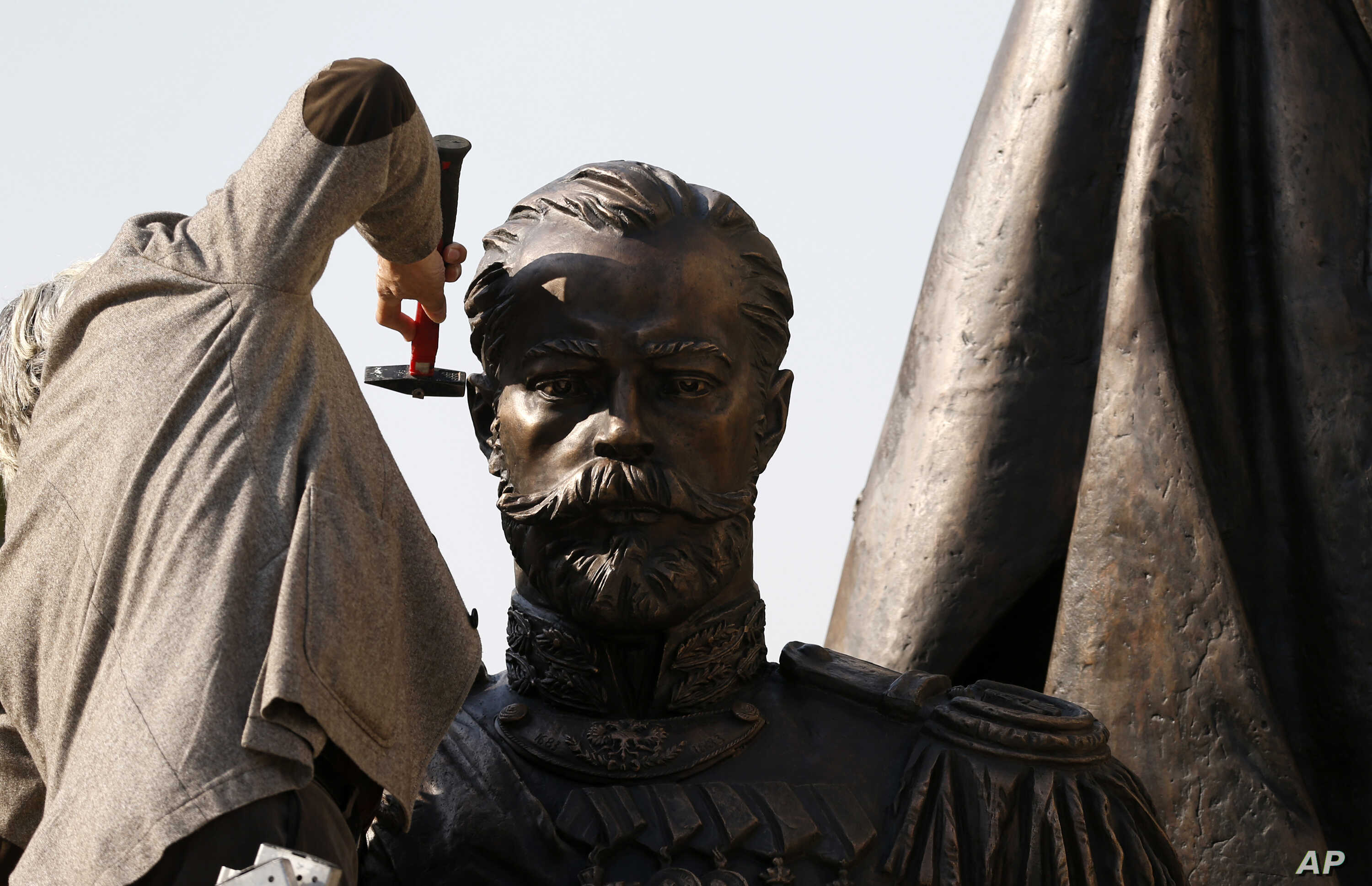FILE - A worker prepares a new statue of Russia's last Czar, Nicholas II, in downtown Belgrade, Serbia, Oct. 13, 2014. Moscow has been slowly losing its clout in Eastern Europe, as countries have joined NATO and the EU.