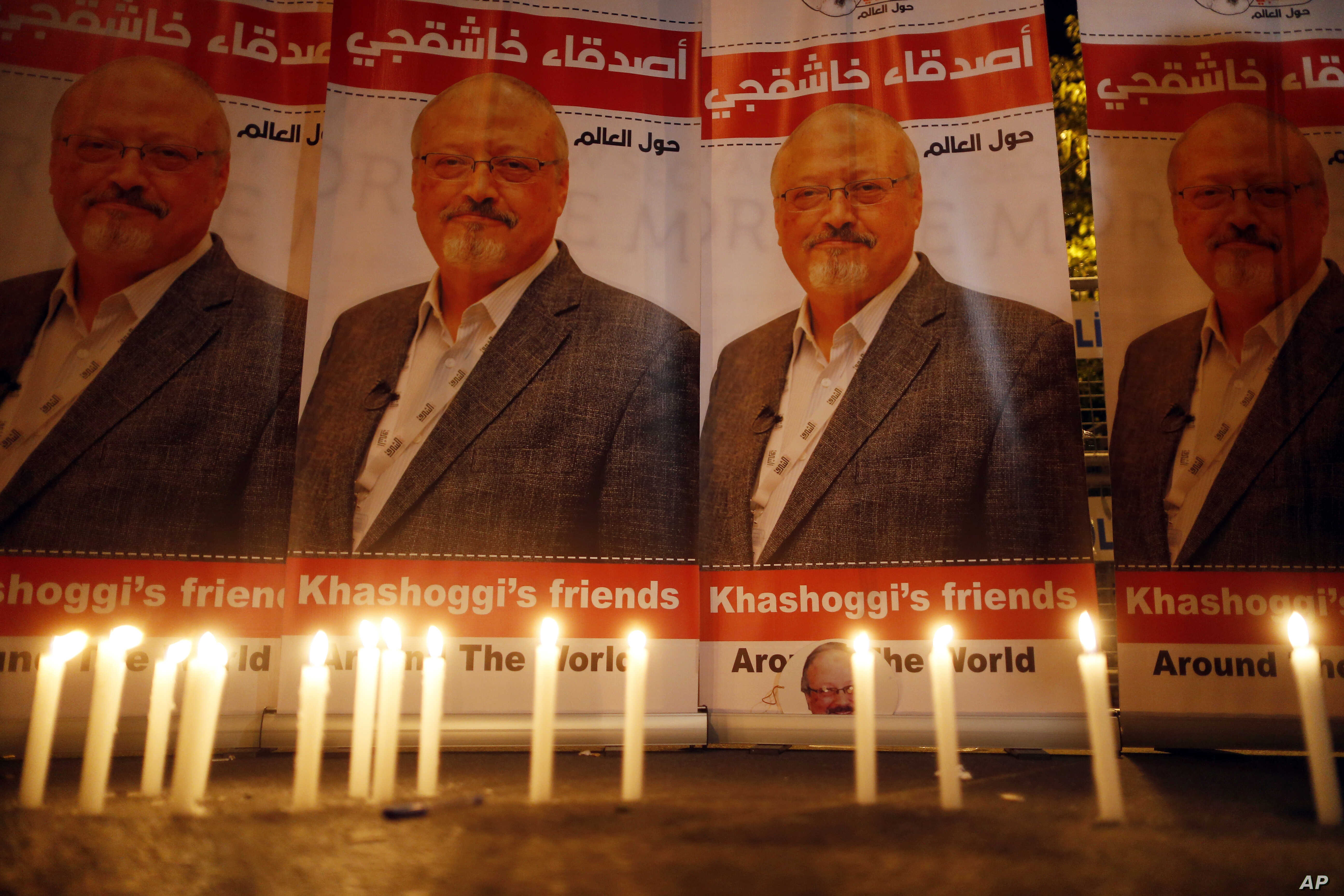 Candles, lit by activists, protesting the killing of Saudi journalist Jamal Khashoggi, are placed outside Saudi Arabia's consulate, in Istanbul, during a candlelight vigil, Oct. 25, 2018.