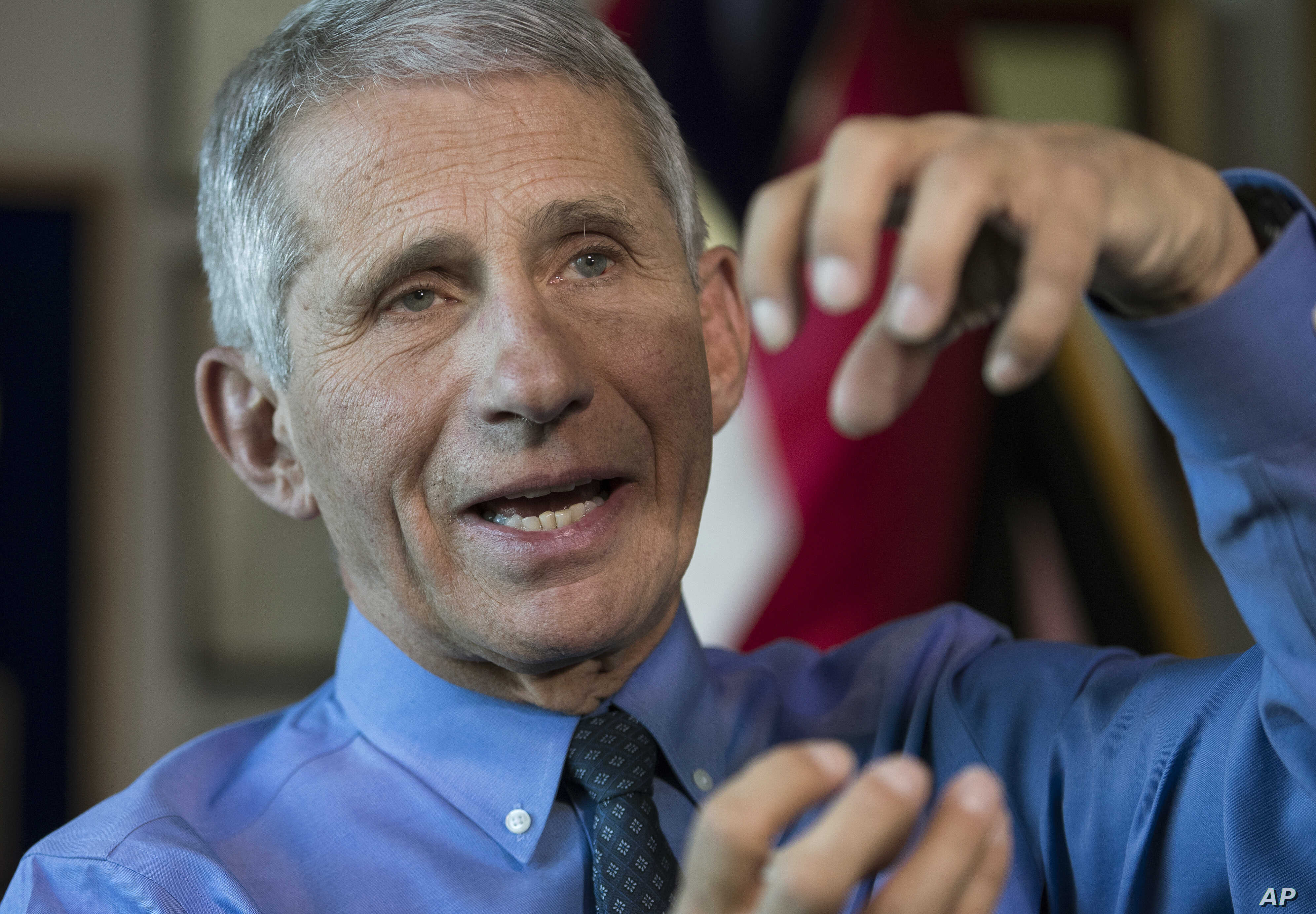 FILE - Dr. Anthony Fauci, director of the National Institute for Allergy and Infectious Diseases, speaks during an interview in his office at the National Institutes of Health in Bethesda, Maryland, Dec. 19, 2017.