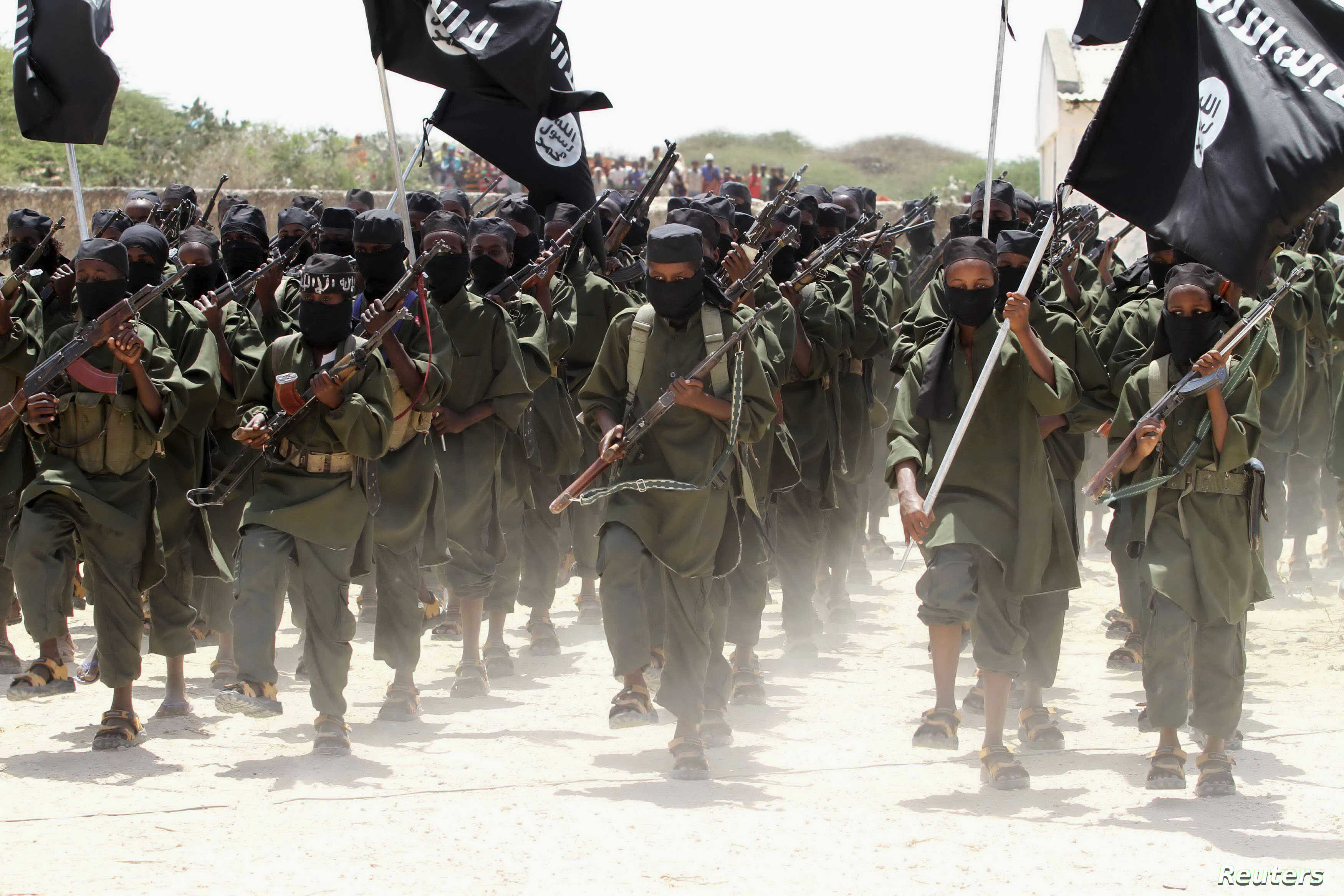 FILE - Recruits belonging to Somalia's al Shabaab rebel group march during a parade at a training base in 2011.