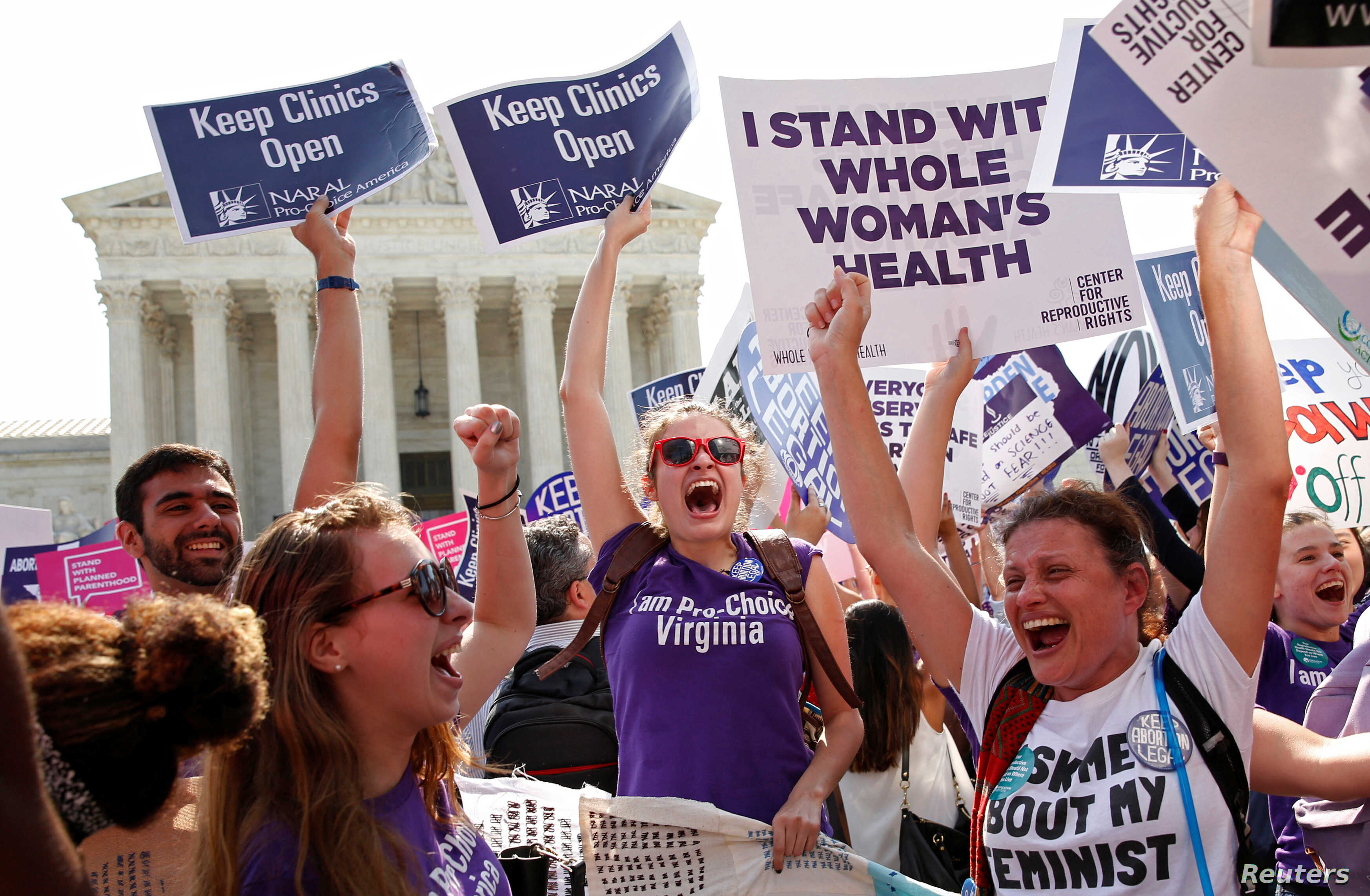 Demonstrators celebrate at the U.S. Supreme Court after the court struck down a Texas law imposing strict regulations on abortion doctors and facilities that its critics contended were specifically designed to shut down clinics in Washington June 27,...
