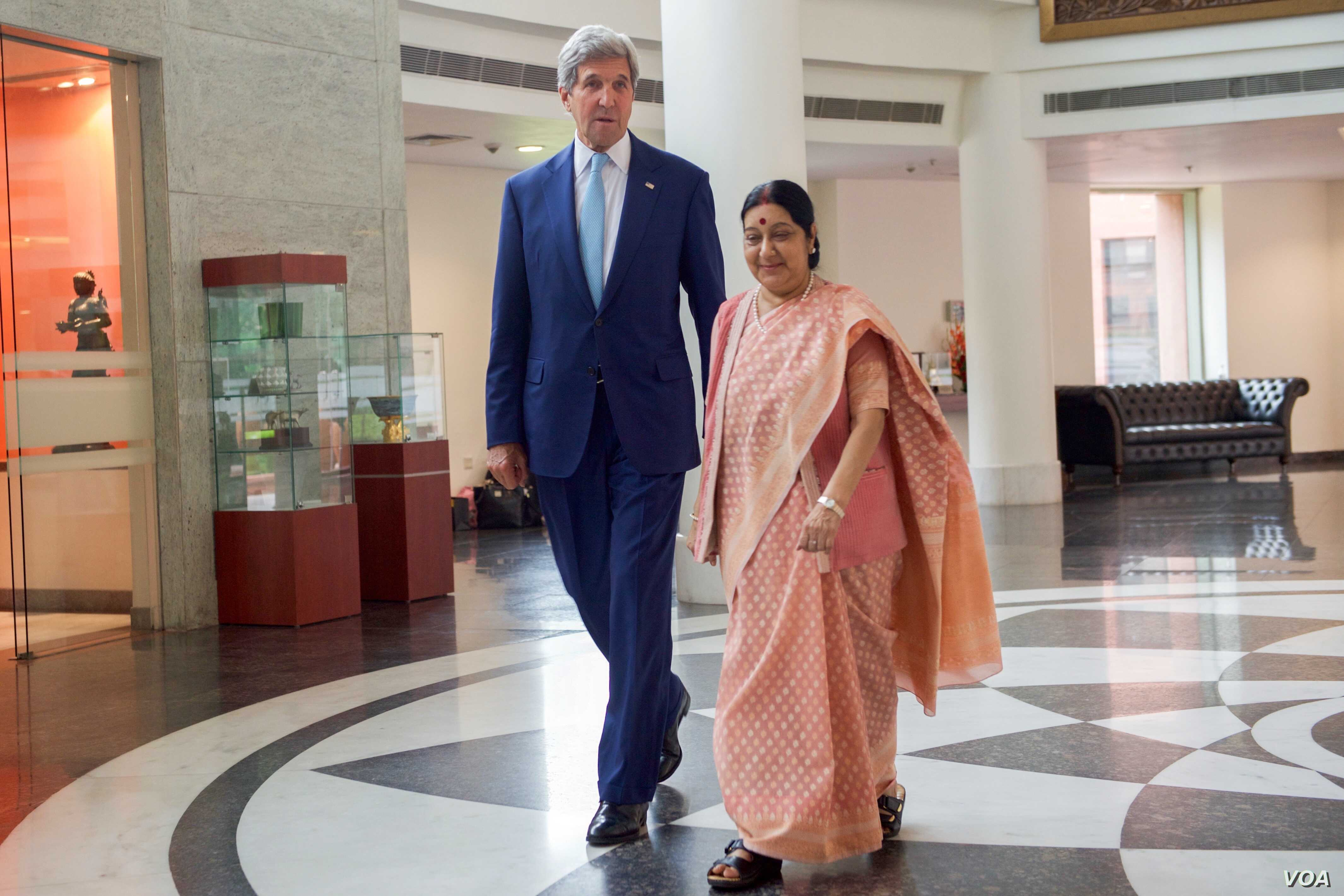 U.S. Secretary of State John Kerry walks with Indian Minister of External Affairs Shushma Swaraj on August 30, 2016, after he arrives at the Jawarhalal Nehru Bhawan in New Delhi, India, for a bilateral meeting.