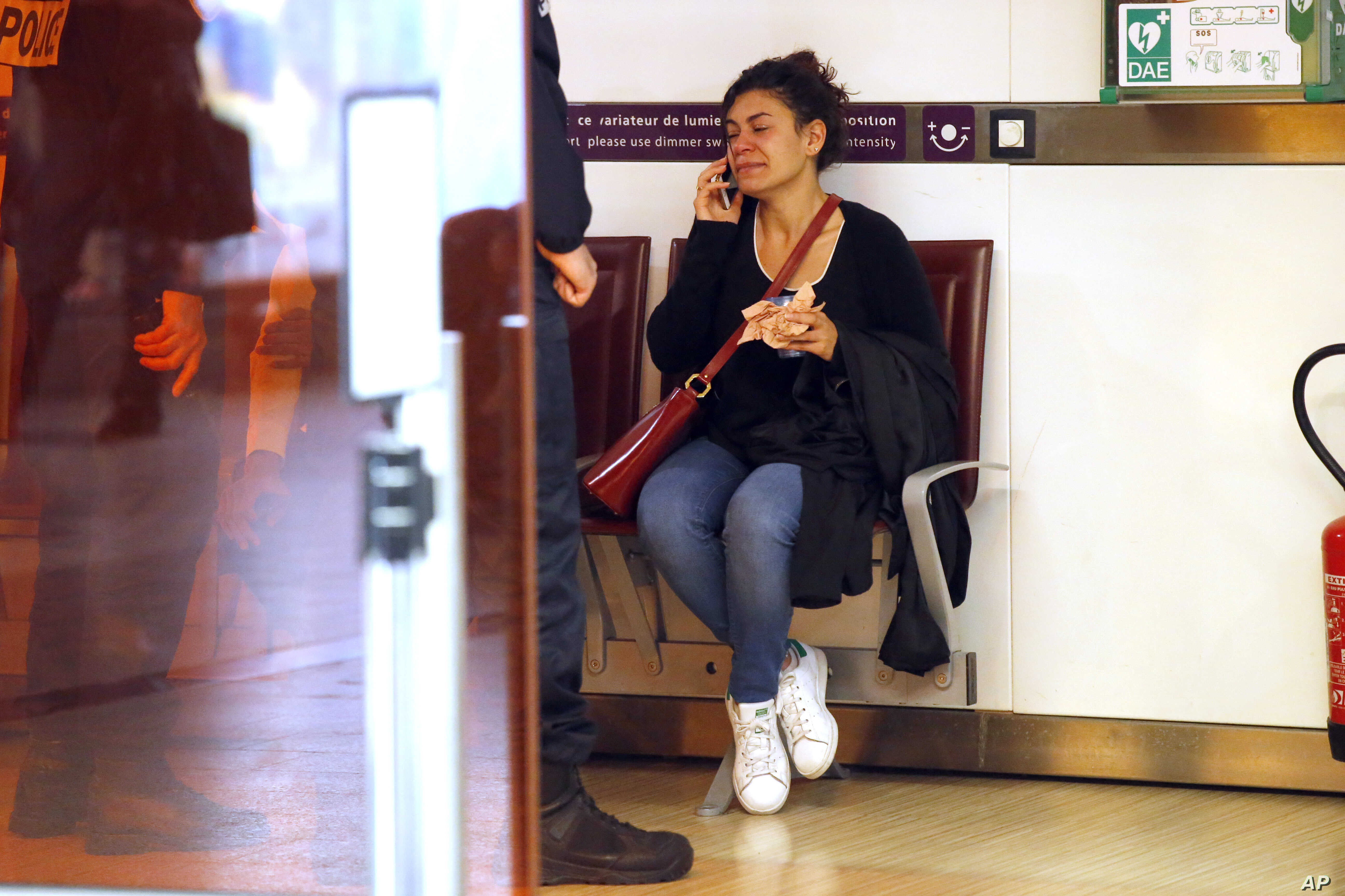 A relative of the victims of the EgyptAir flight 804 that crashed, reacts as she makes a phone call at Charles de Gaulle Airport outside of Paris, Thursday, May 19, 2016.