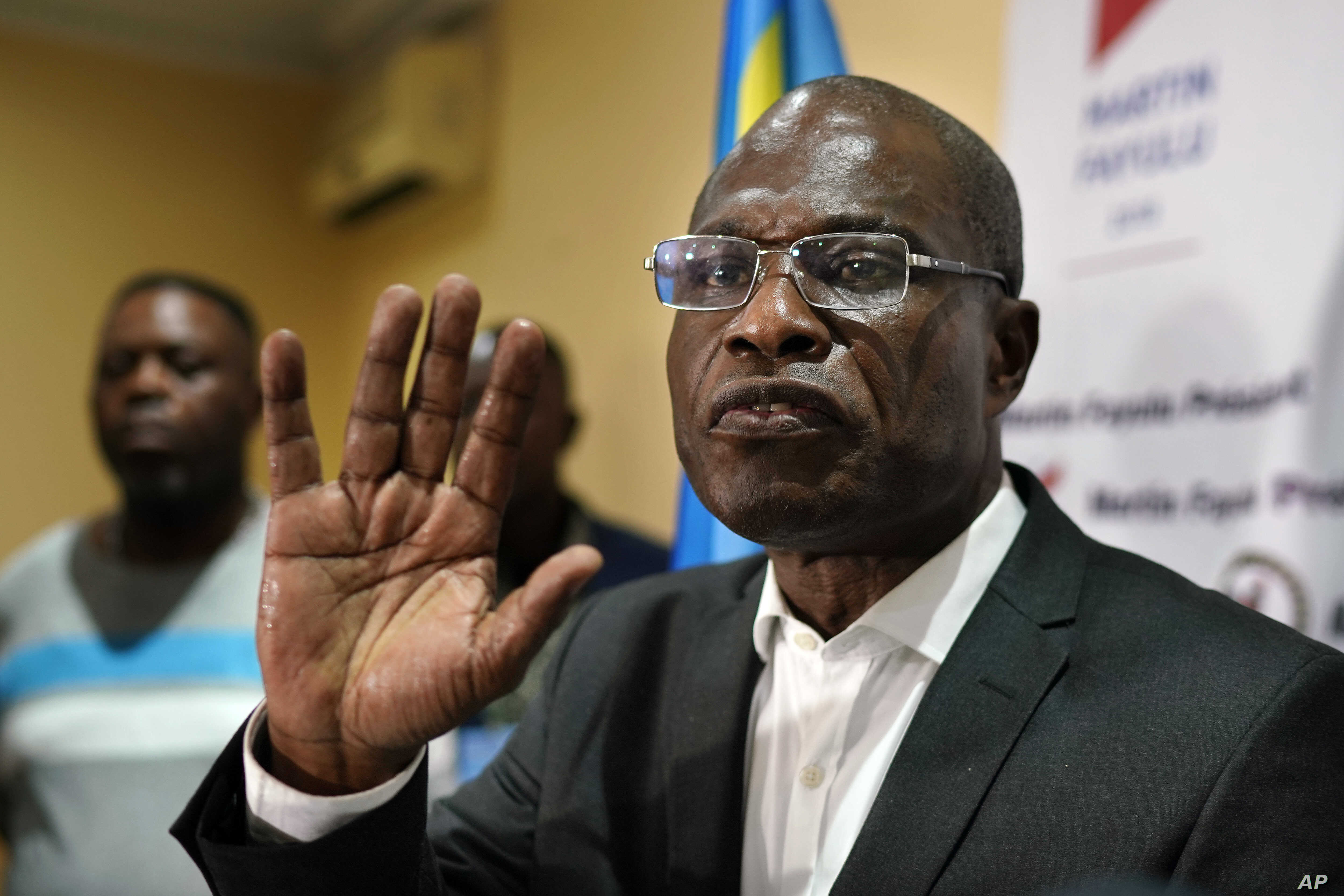 Opposition candidate Martin Fayulu speaks to the press at his headquarters in Kinshasa, Congo, Jan. 10, 2019. Fayulu, who came second in the presidential poll behind Felix Tshisekedi, called the results fraudulent.