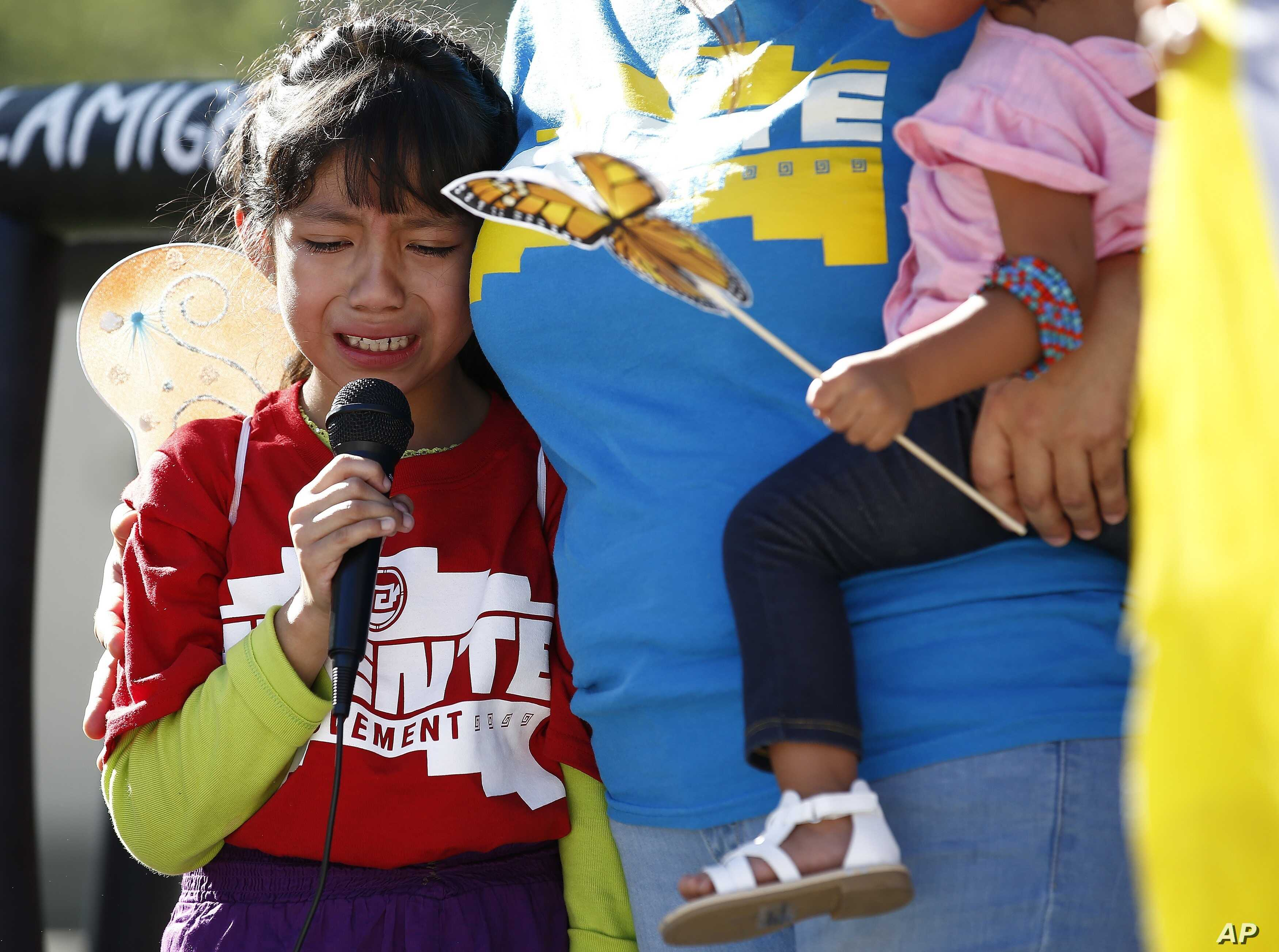 Akemi Vargas, 8, cries as she talks about being separated from her father during a family separation protest in Phoenix, Arizona, June 18, 2018.