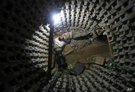 A Palestinian worker takes a break from working on a smuggling tunnel between Egypt's Sinai and the Gaza Strip.