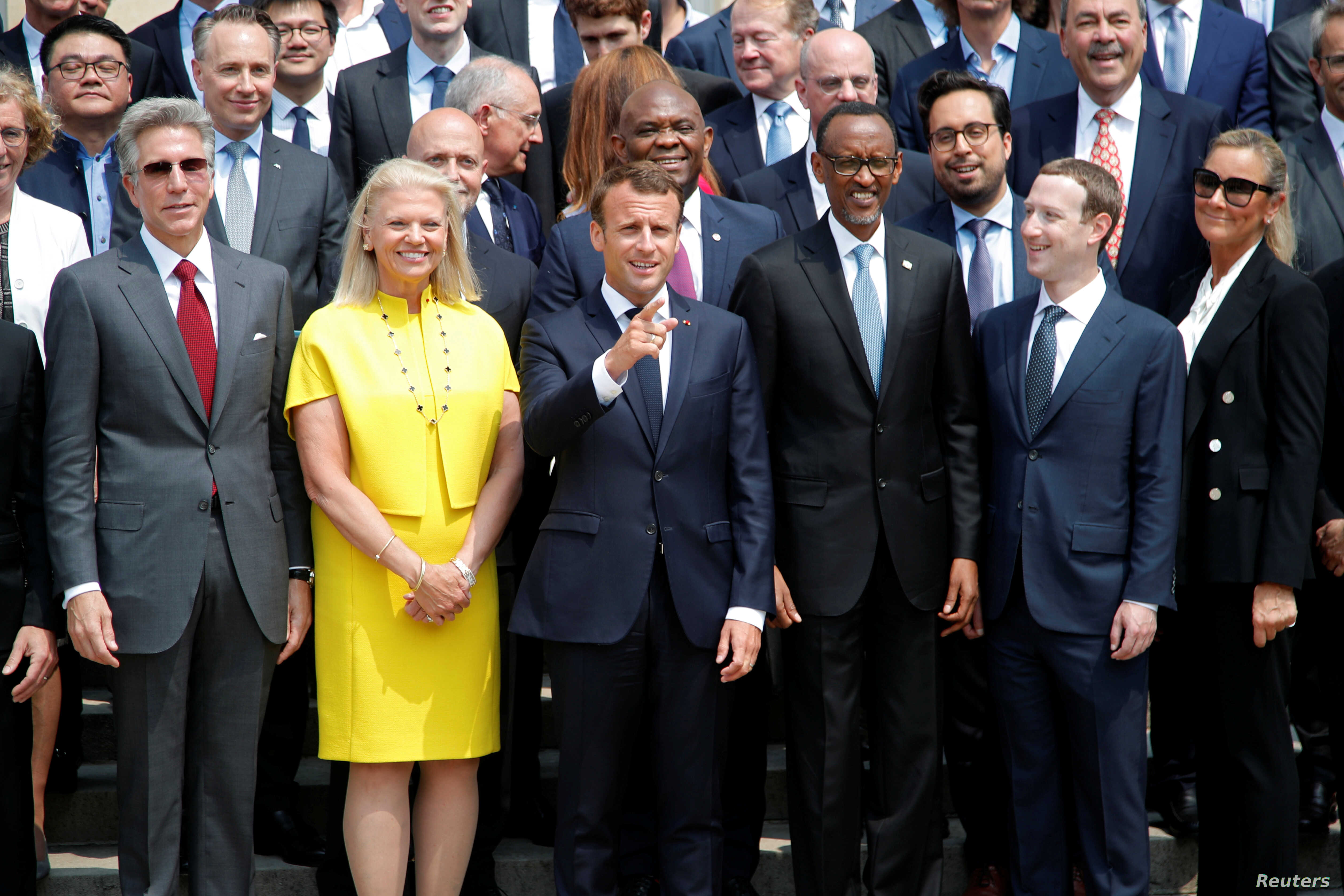 French President Macron poses for a family picture with Rwanda's President Kagame, Facebook's CEO Mark Zuckerberg and IMB's CEO Virginia Rometty at the Elysee Palace in Paris, May 23, 2018.