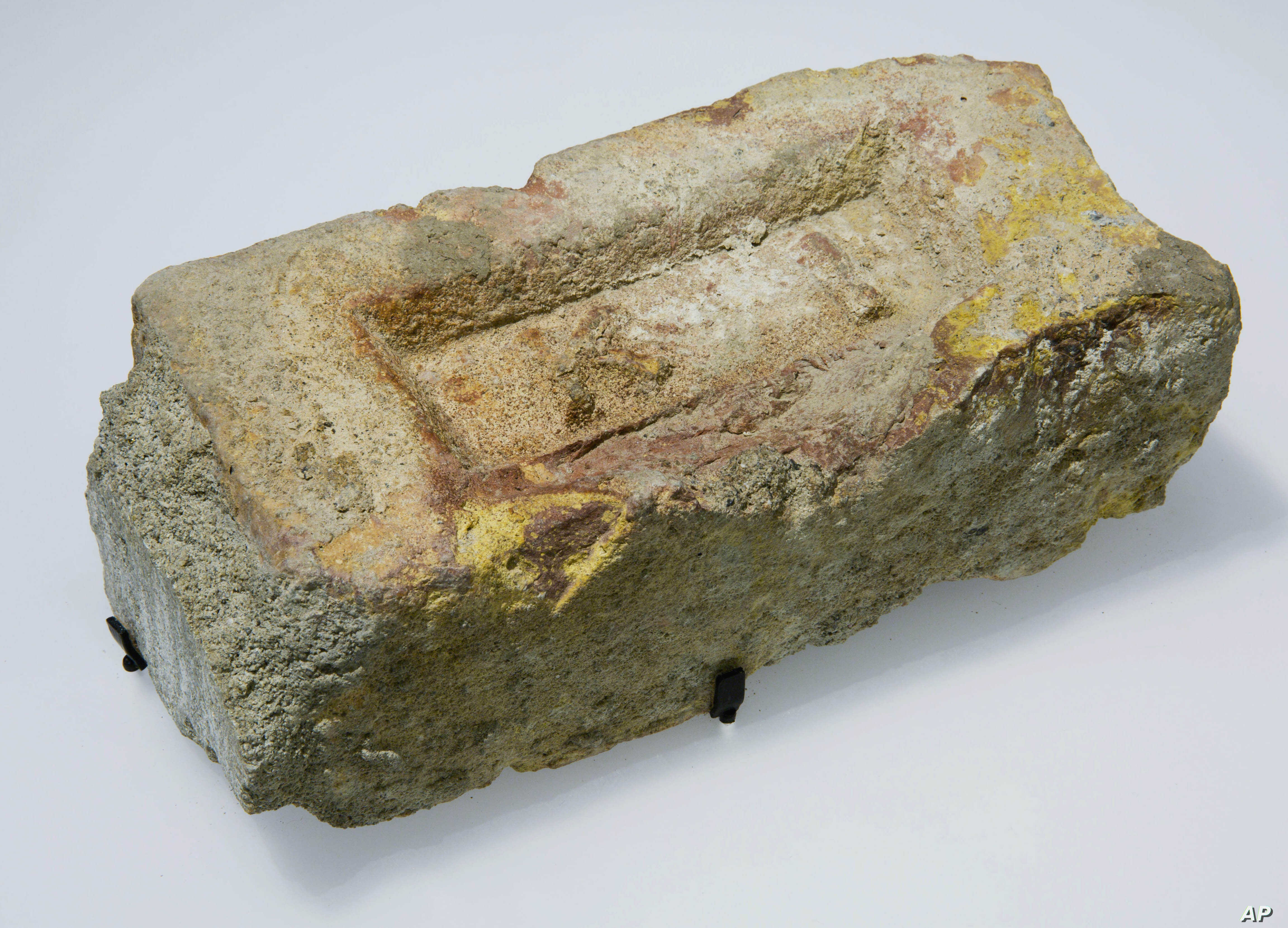 In this Sept. 5, 2014 photo provided by the National September 11 Memorial & Museum, a brick from the compound in Abbottabad, Pakistan, where Osama bin Laden was captured and killed, is shown at the museum in New York.