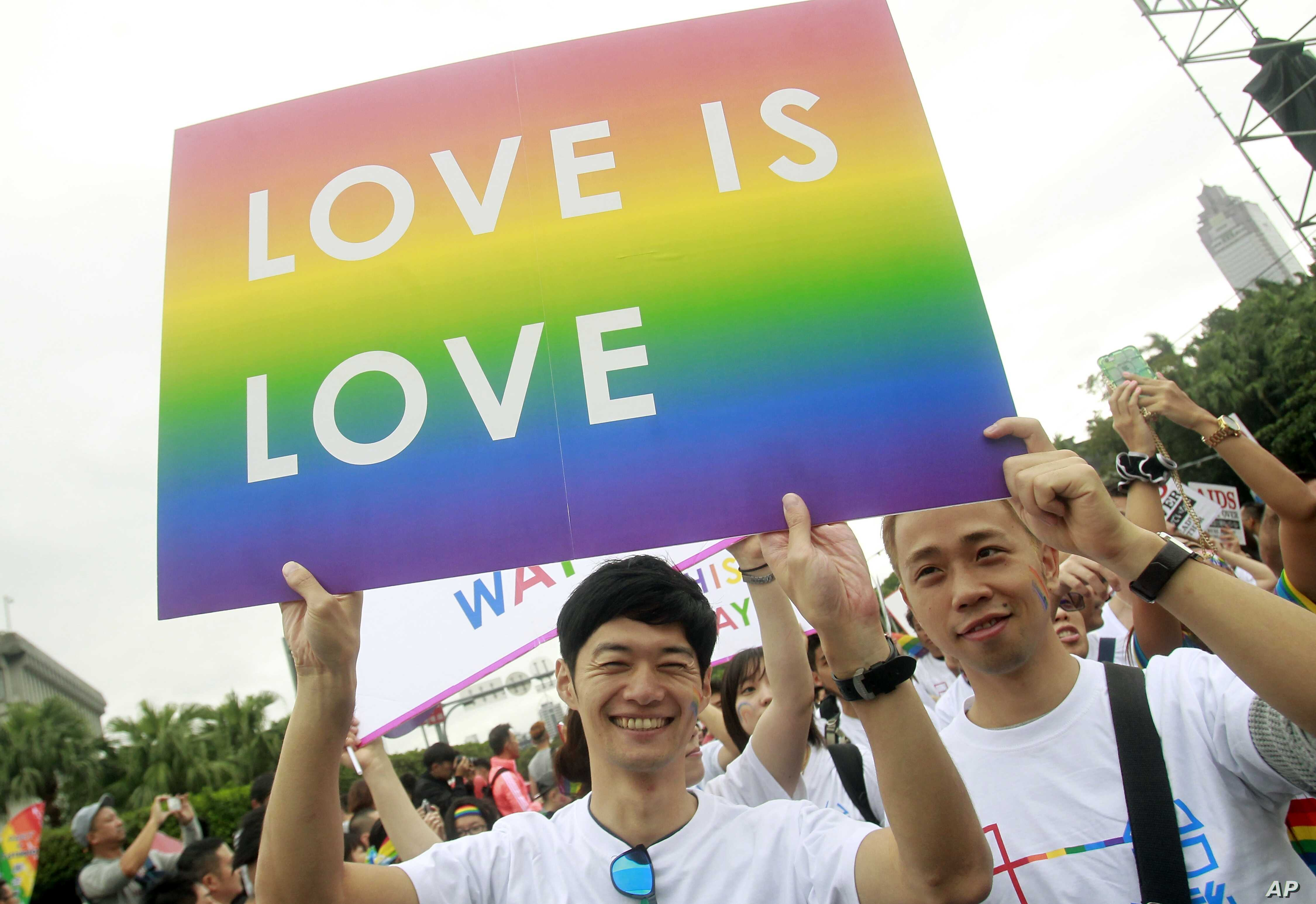 FILE - Revelers participate in a gay pride parade in Taipei, Taiwan. Taiwan is shaping up become the first place in Asia to allow same-sex marriage.