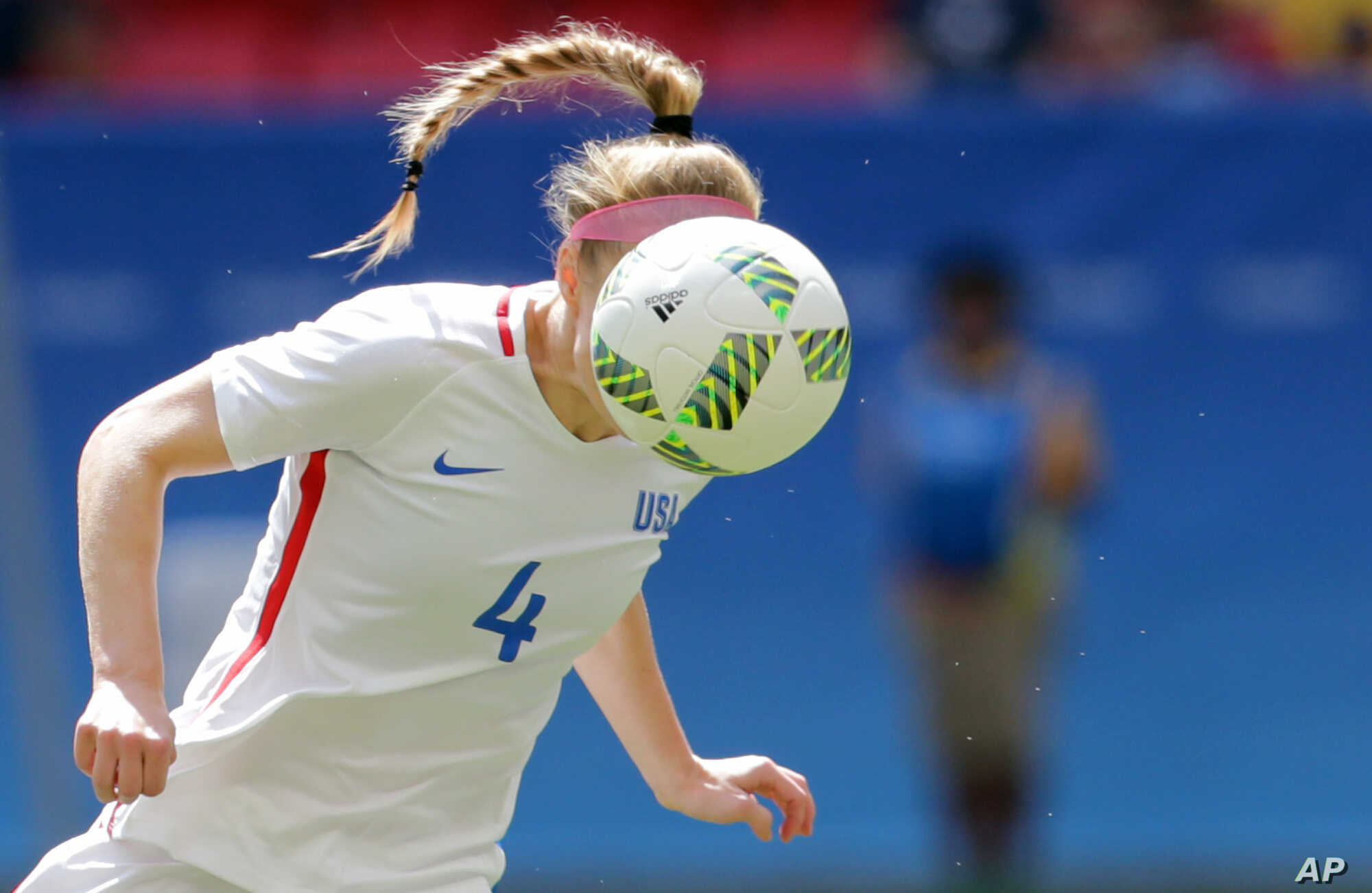 United States' Becky Sauerbrunn hits a header during a quarterfinals loss to Sweden at women's Olympic tournament  in Brasilia, Aug. 12, 2016.