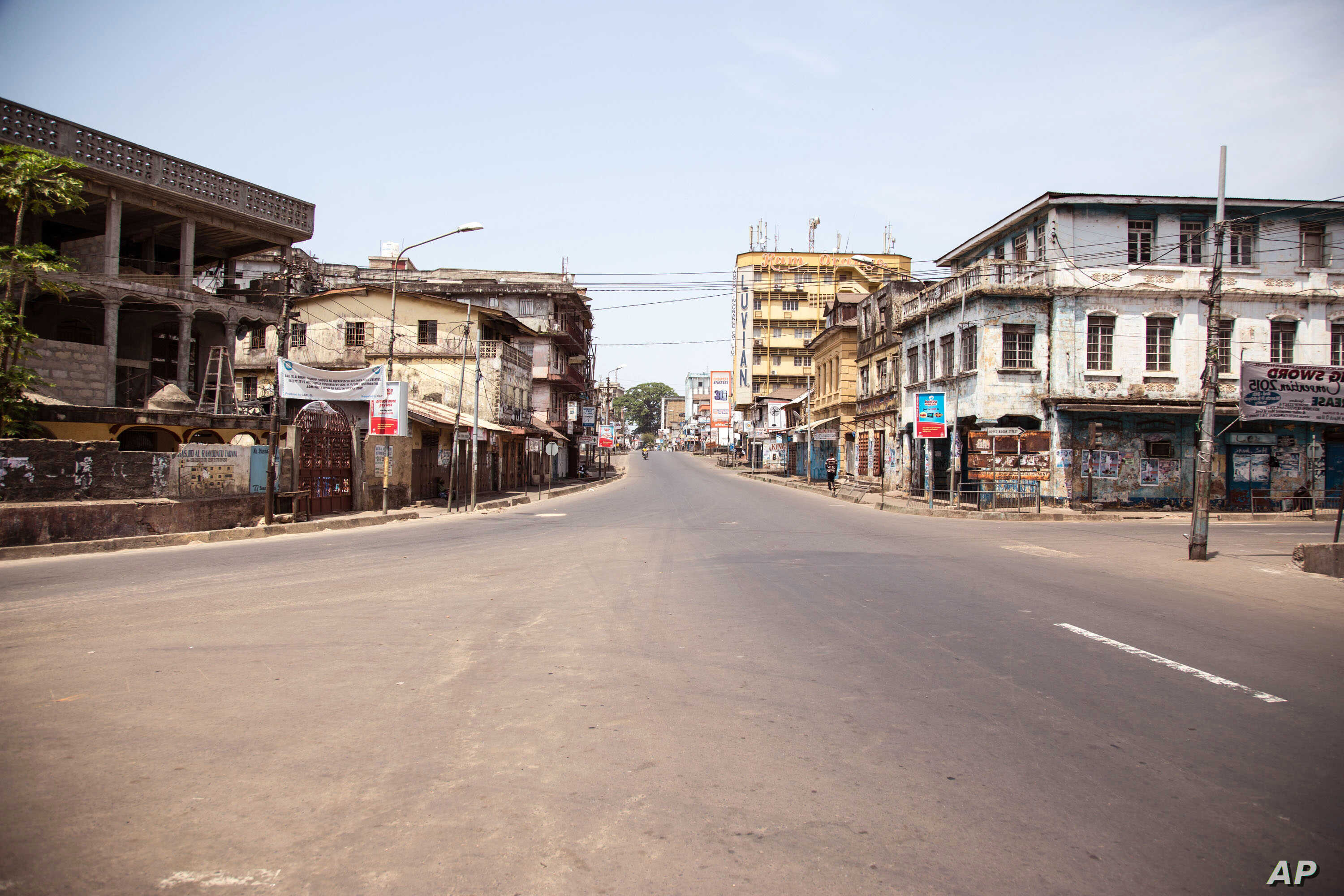 A empty street in Sierra Leone is seen, as the country enters the third and final day of a three day country wide lockdown on movement of people to combat the Ebola virus in the city of Freetown, Sierra Leone, Sunday, March. 29,  2015.