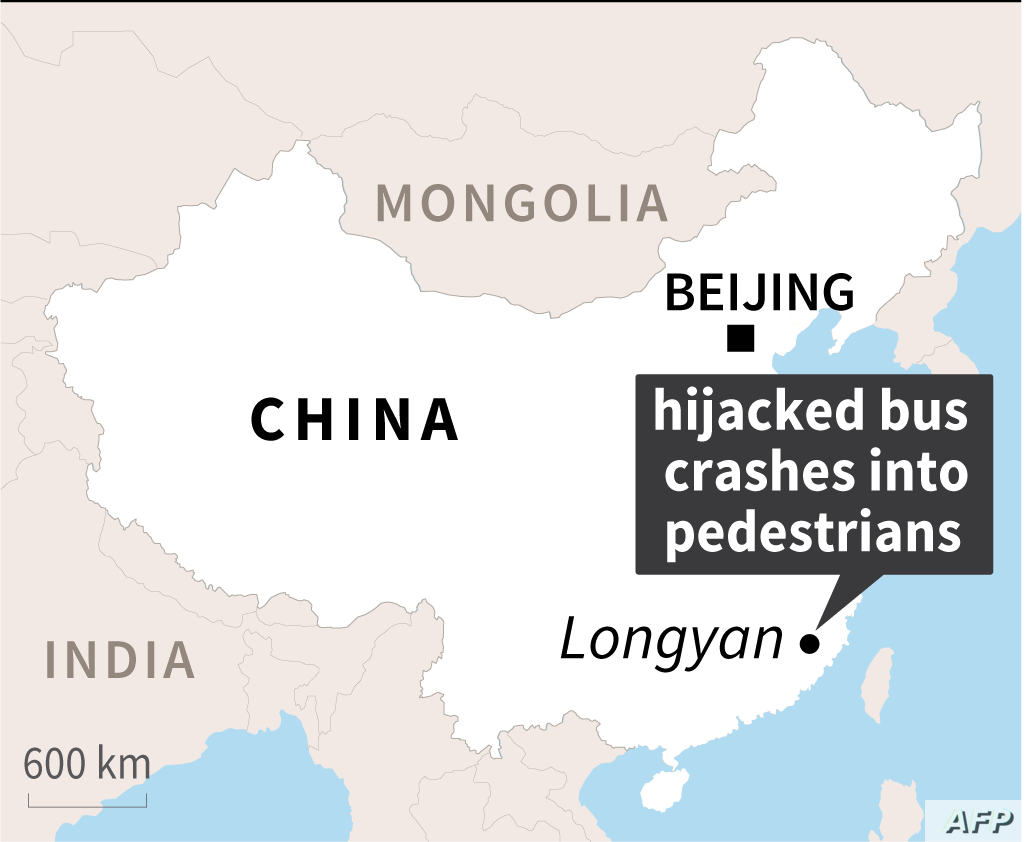 Eight Killed in China as Hijacked Bus Crashes into ...