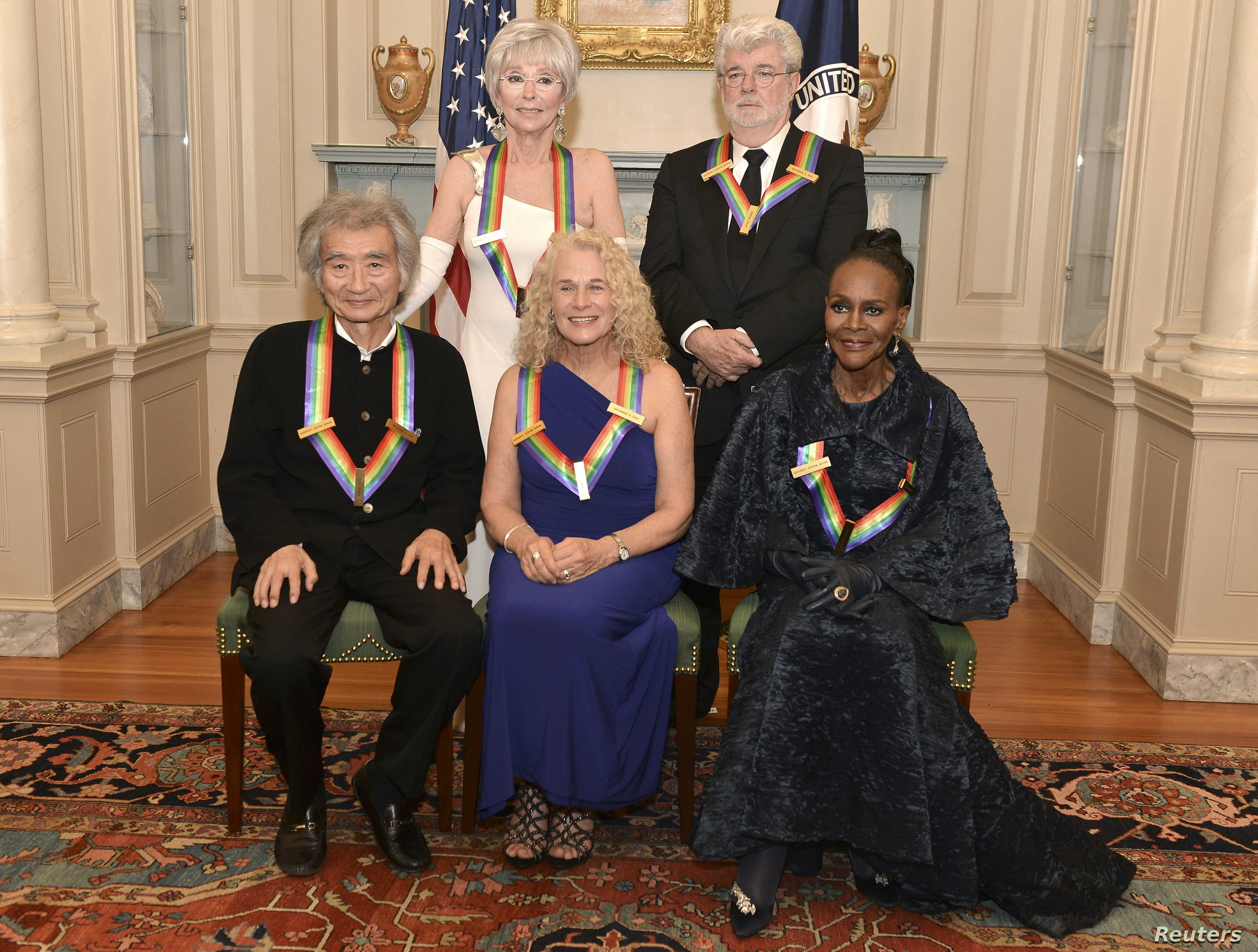 Kennedy Center Honorees (L-R, standing) actress and singer Rita Moreno, filmmaker George Lucas, (L-R, seated) Japanese conductor Seiji Ozawa, singer-songwriter Carole King and actress Cicely Tyson gather for a group photo after a gala dinner at the U...