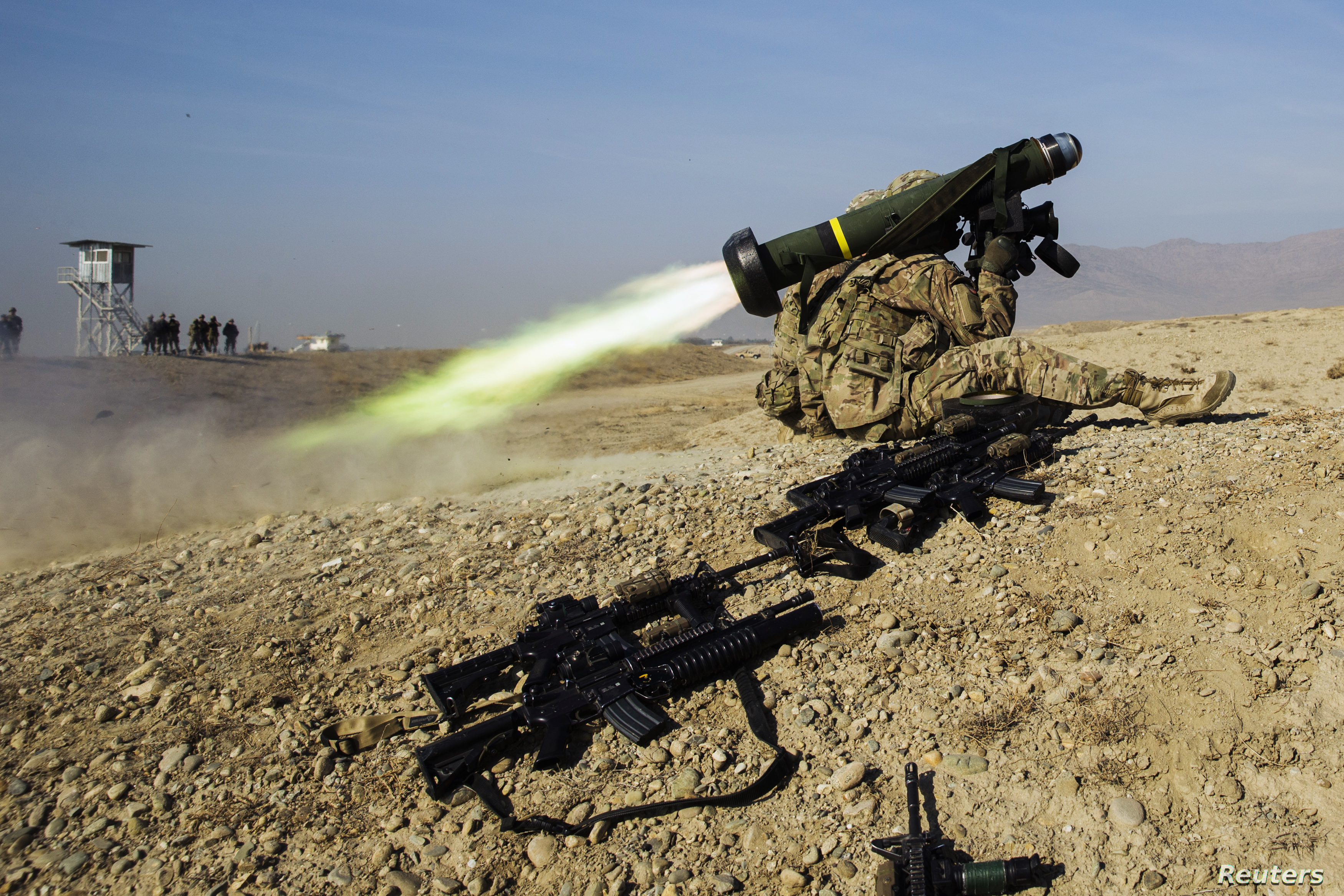 A U.S. soldier from Dragon Troop of the 3rd Cavalry Regiment fires a Javelin missile system during their first training exercise of the new year near operating base Gamberi in the Laghman province of Afghanistan January 1, 2015. REUTERS/Lucas Jackson...