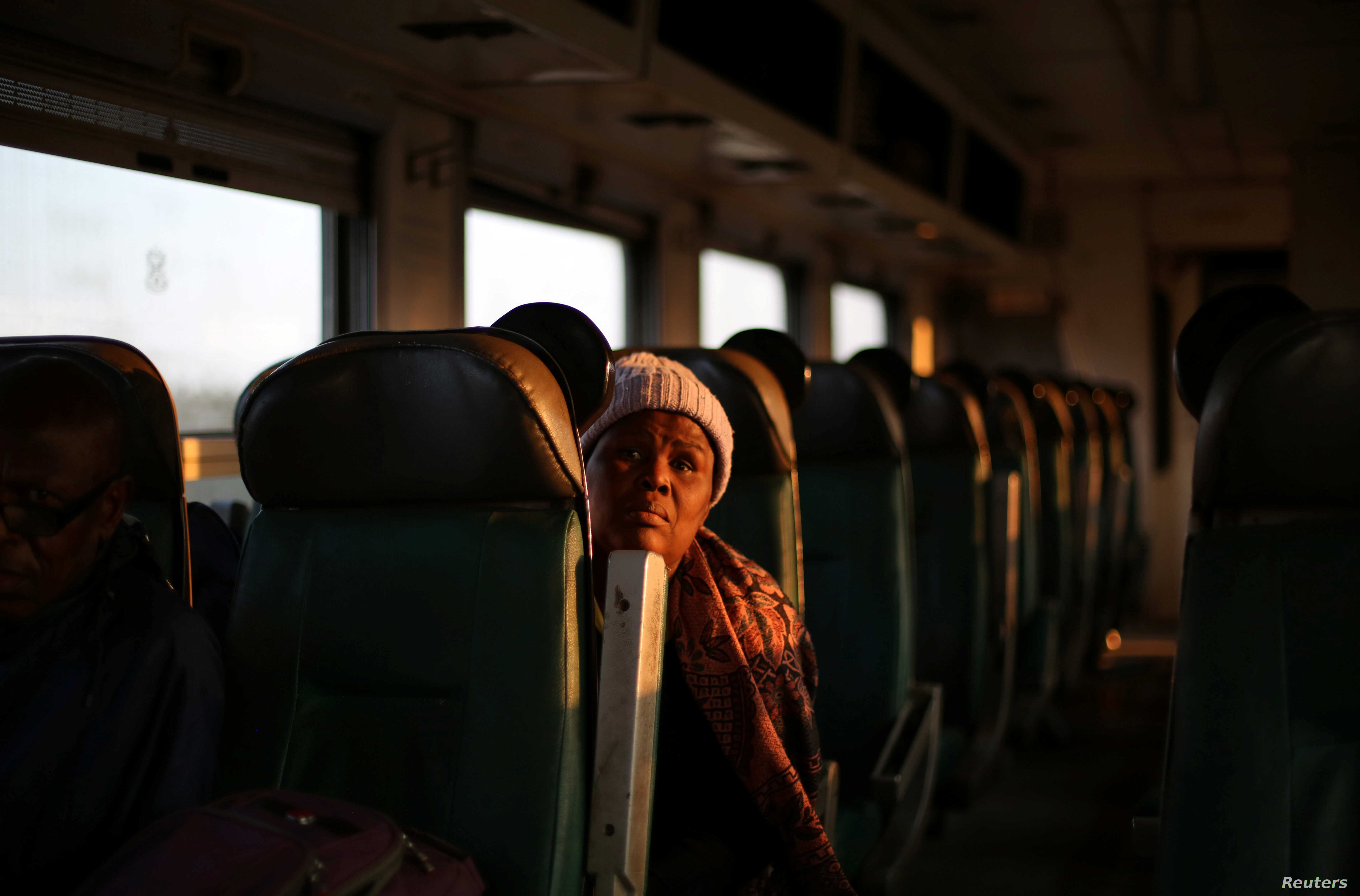 A passenger travels on a sleeper train from Harare to Bulawayo, Zimbabwe, Aug. 6, 2018.