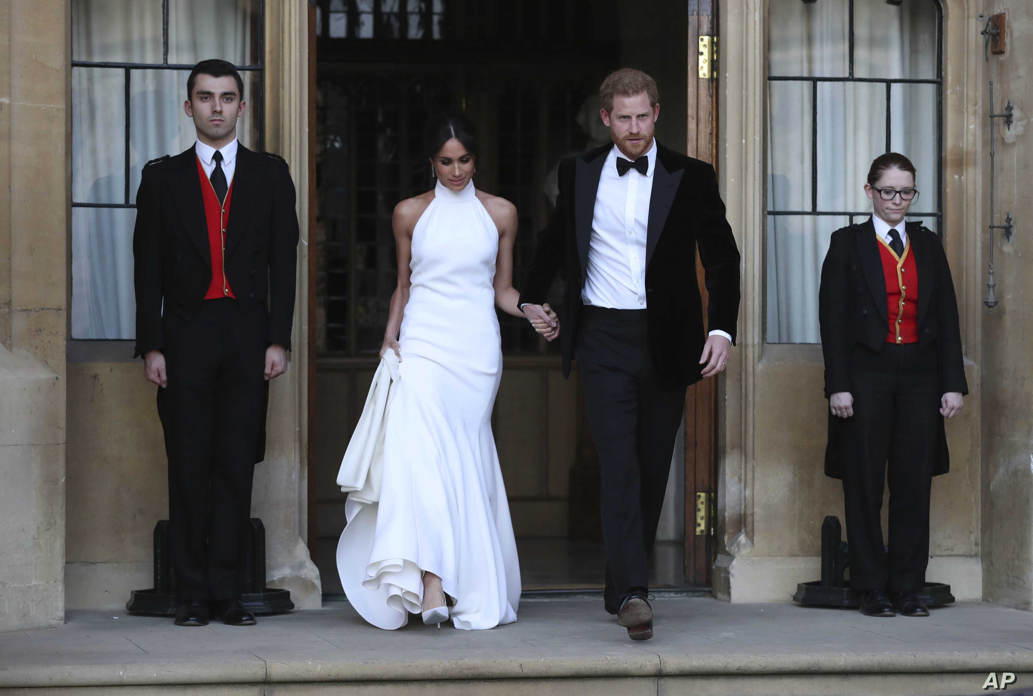 The newly married Duke and Duchess of Sussex, Meghan Markle and Prince Harry, leave Windsor Castle after their wedding in Windsor, to attend an evening reception at Frogmore House, hosted by the Prince of Wales, May 19, 2018.