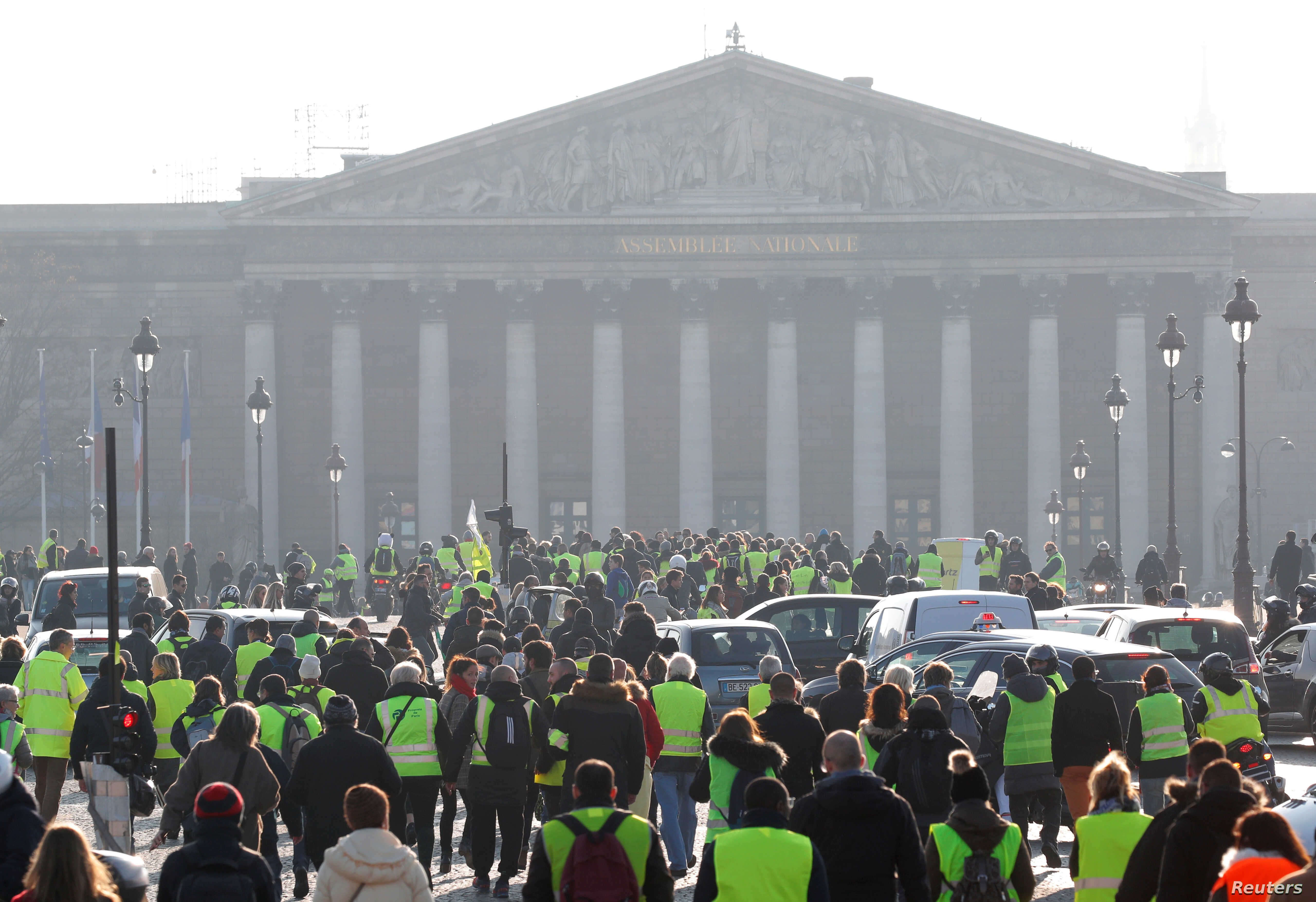 """""""Yellow vest"""" protesters are seen gathered near the National Assembly in Paris, France, Nov. 17, 2018."""