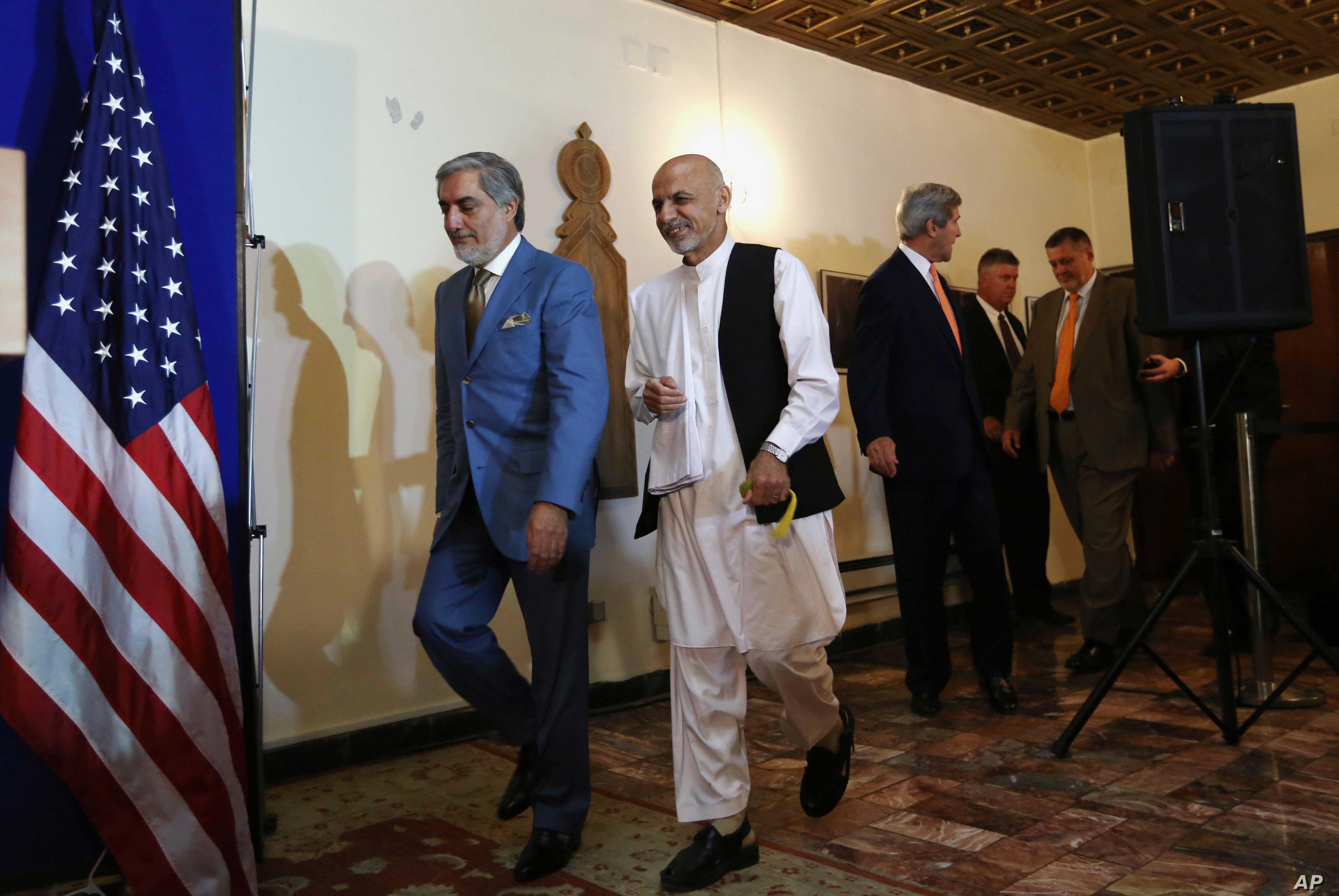 Afghan presidential candidates Abdullah Abdullah, from left, and Ashraf Ghani Ahmadzai and U.S. Secretary of State John Kerry arrive at a joint press conference in Kabul, Afghanistan, Friday, Aug. 8, 2014.