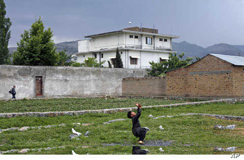 A boy plays with a tennis ball in front of Osama bin Laden's compound in Abbottabad, Pakistan, May 2011. (file photo) Osama bin Laden was killed almost a year ago, on May 2, 2011, by a United States special operations military unit in a raid on his c