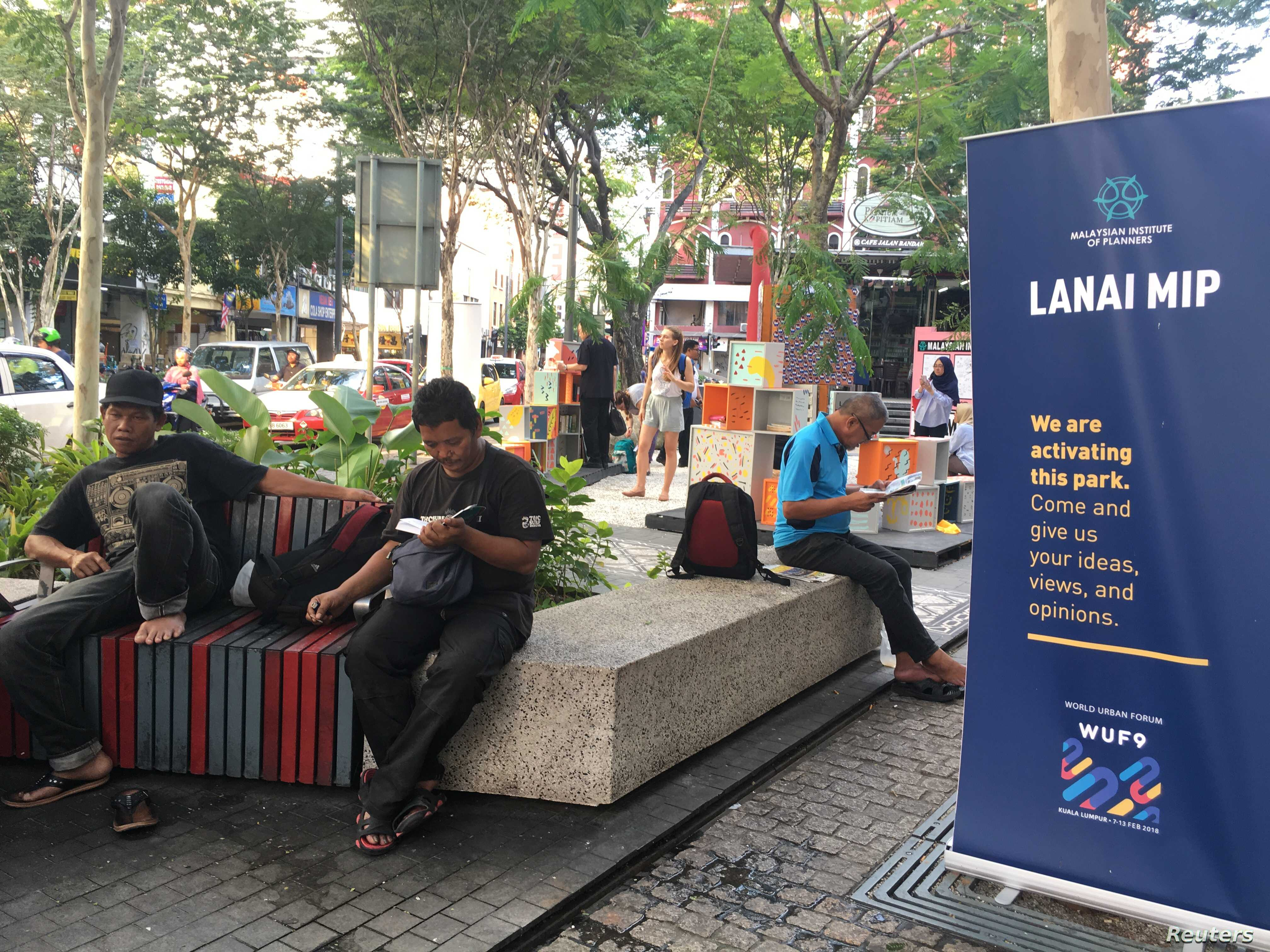 A group of people enjoy a new pop-up space in Kuala Lumpur's old city, Malaysia, Feb. 2018.