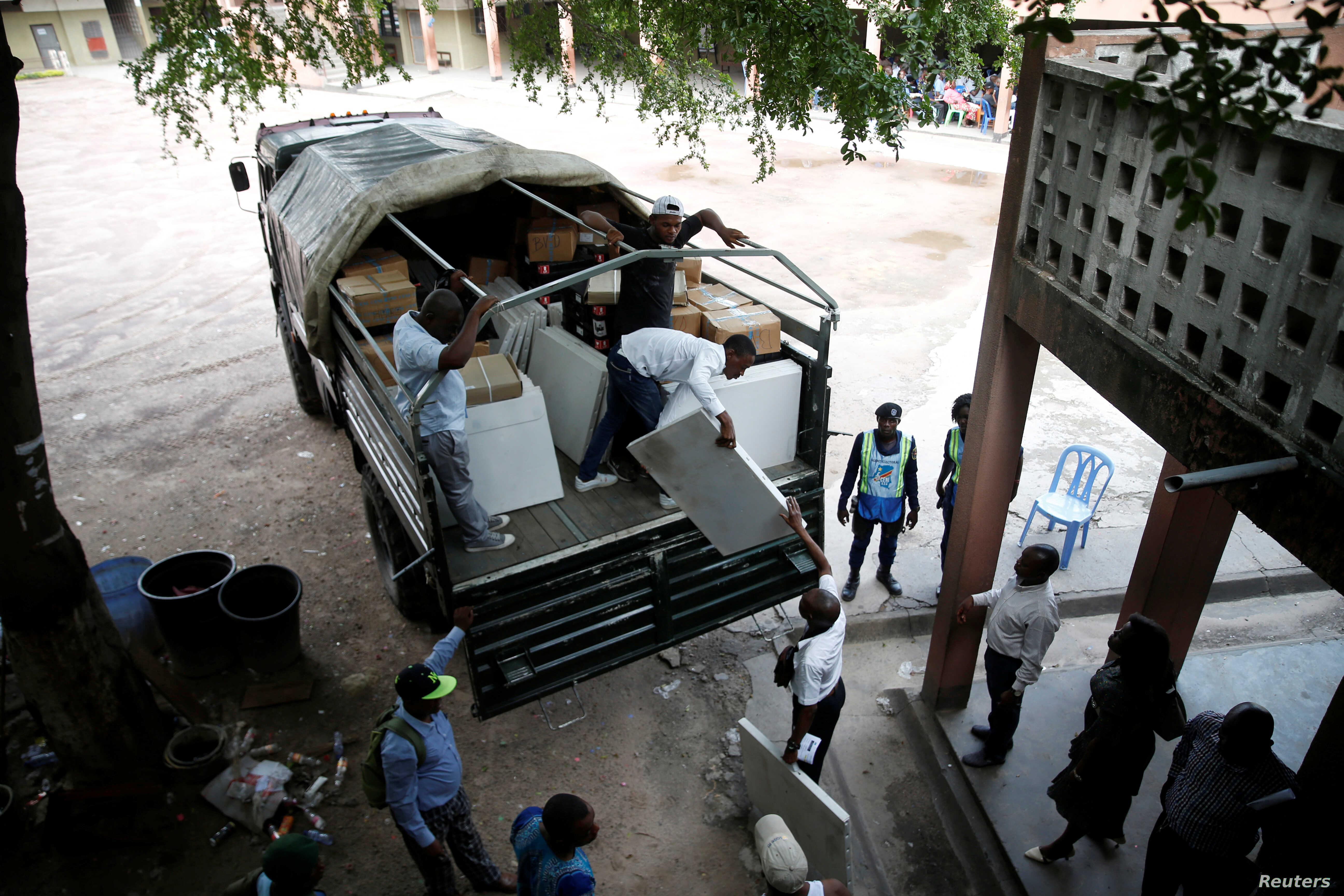 Employees of Congo's Independent National Electoral Commission (CENI) deliver voting machines and materials to a polling station in Kinshasa, Democratic Republic of Congo, Dec. 27, 2018.