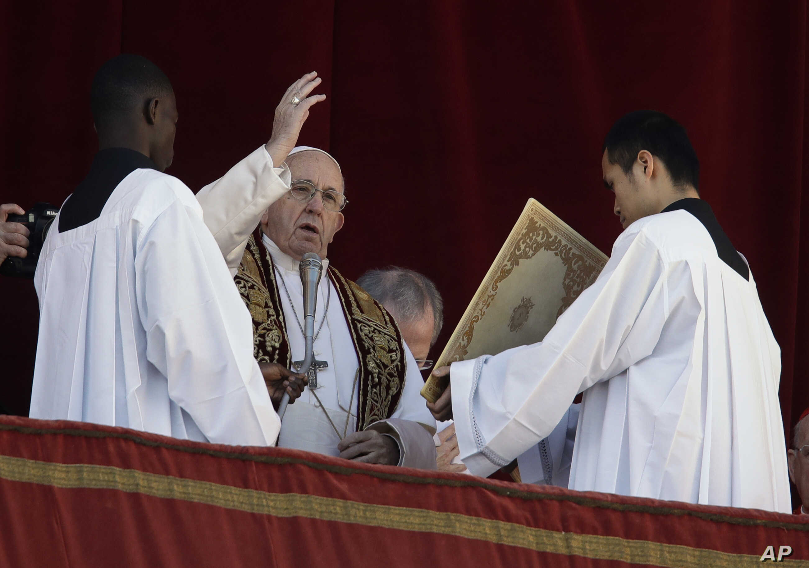 Pope Francis delivers the Urbi et Orbi blessing from the main balcony of St. Peter's Basilica at the Vatican, Dec. 25, 2018.