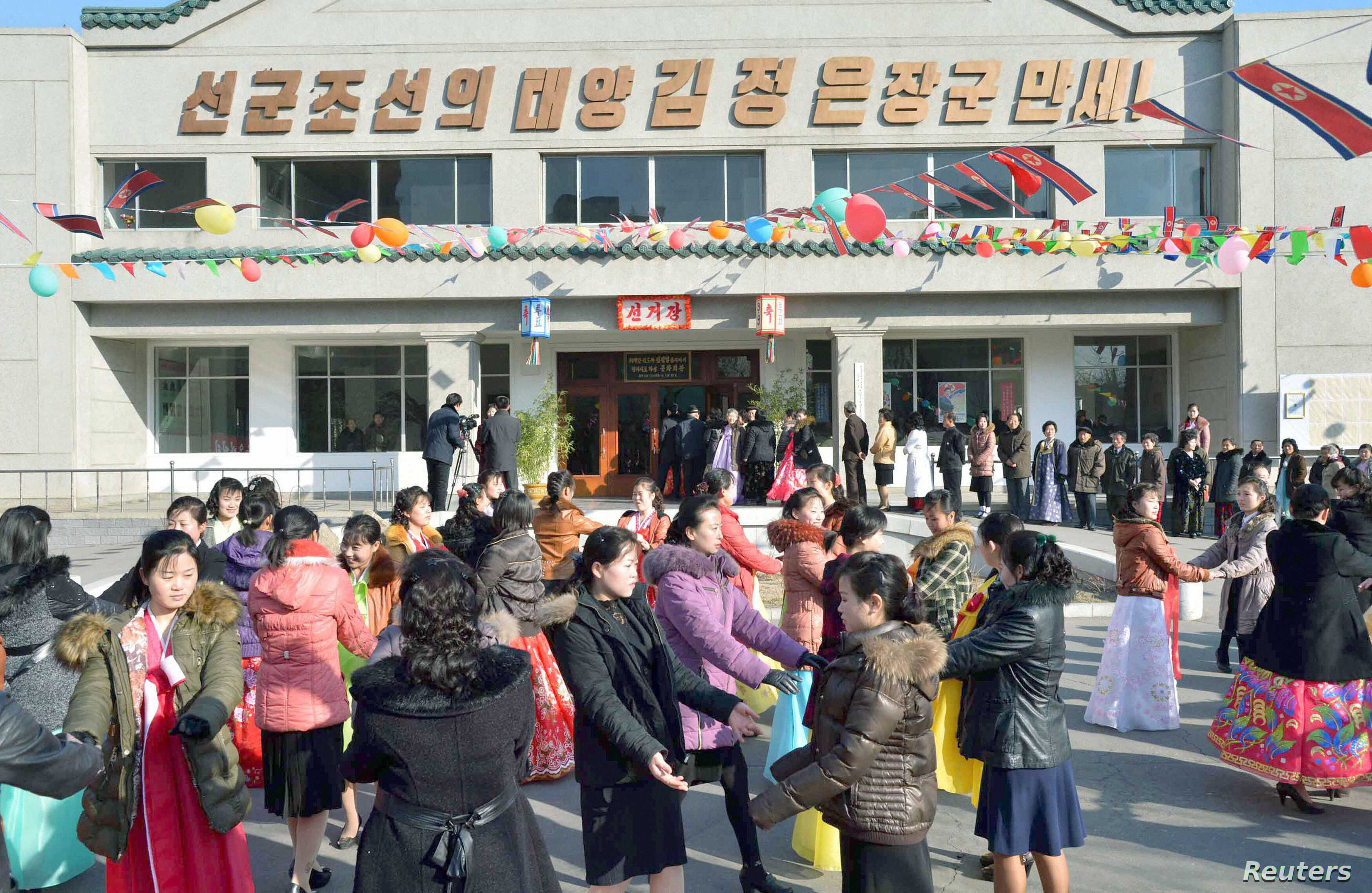 People dance to celebrate as the nation holds elections for deputies to the 13th Supreme People's Assembly (SPA) in Pyongyang, March 9, 2014. North Korea holds nation-wide elections to pick deputies to the Supreme People's Assembly for a new five-ye...