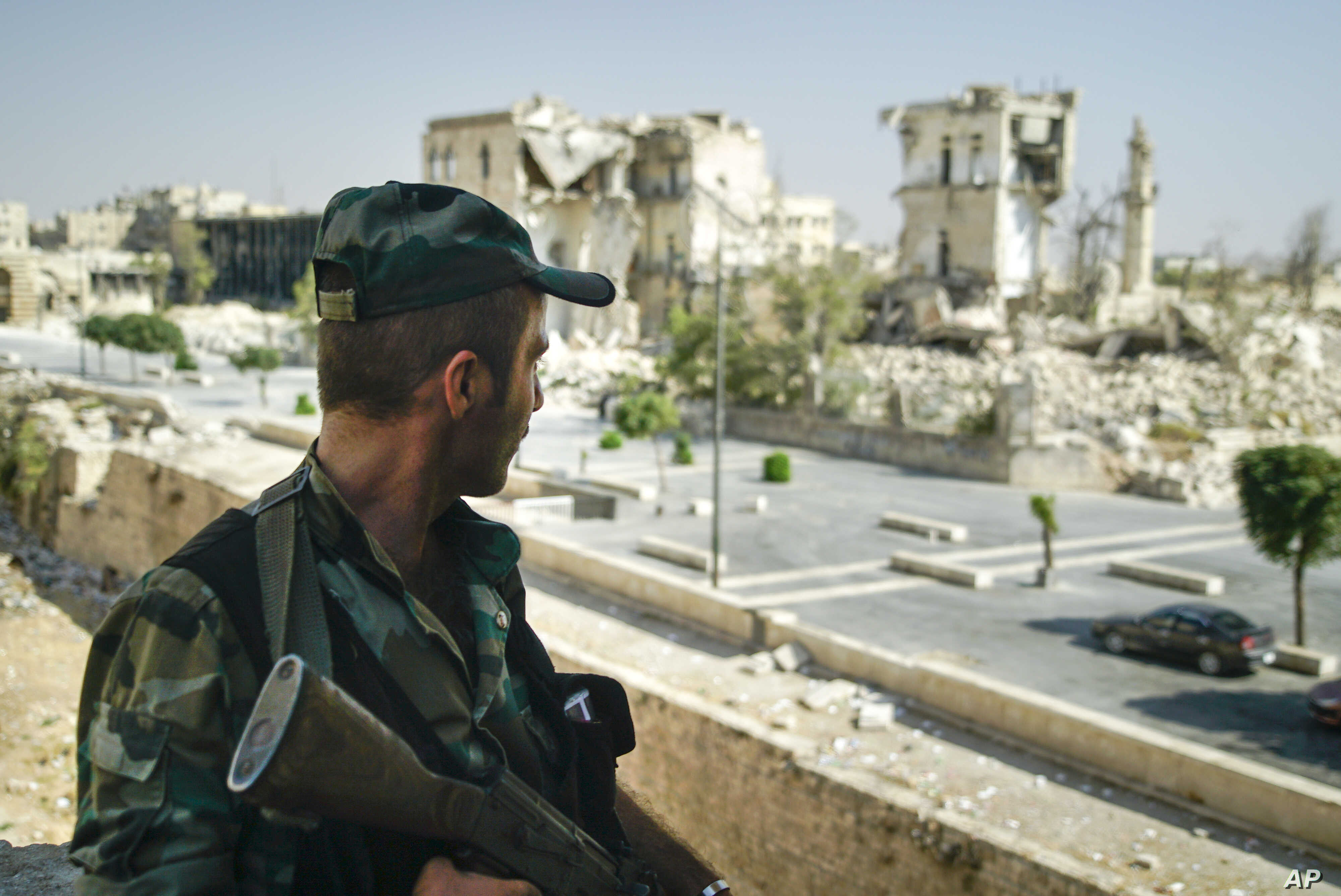 A Syrian soldier guards streets in Aleppo, Syria, Sept. 12, 2017.