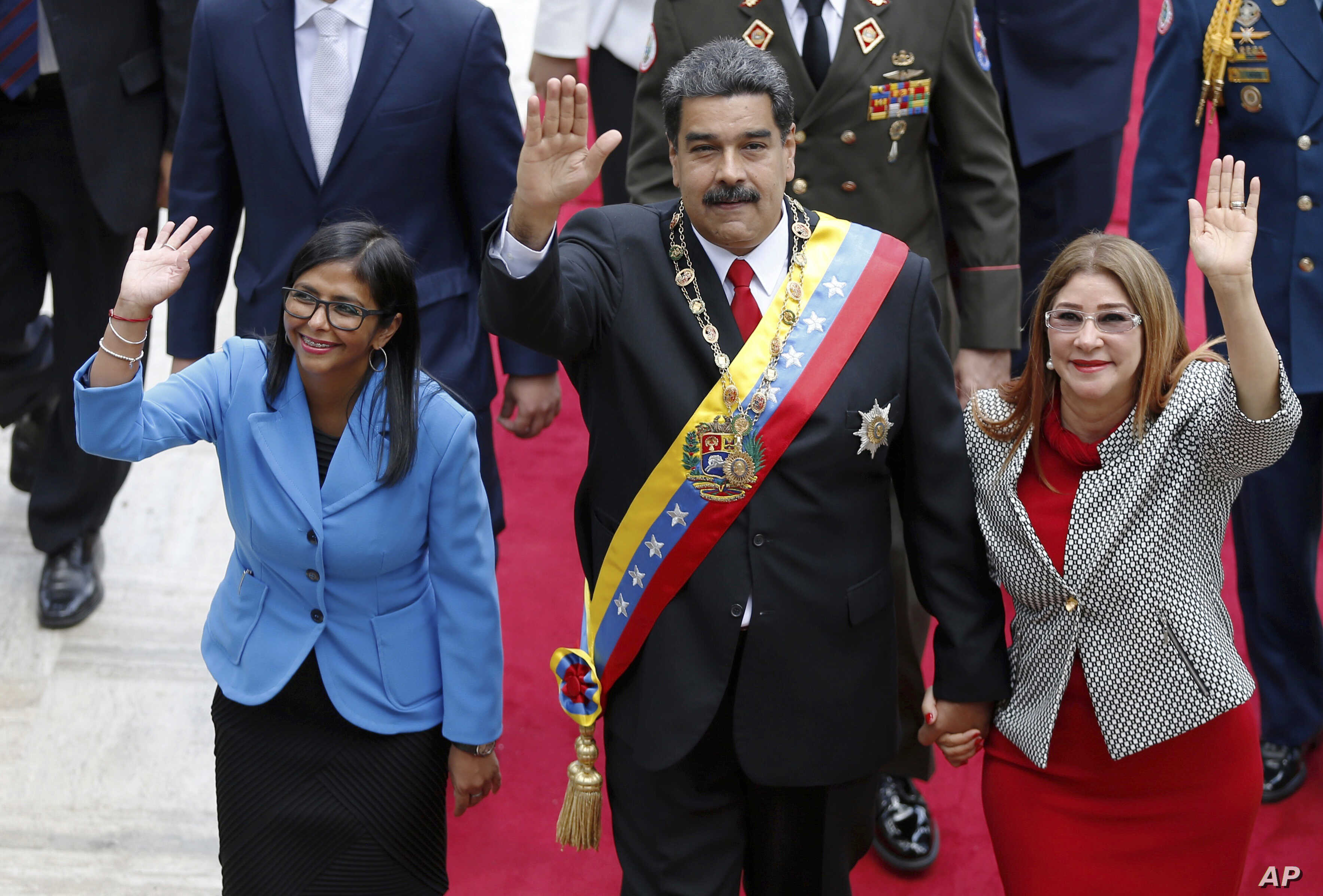 FILE - Venezuela's President Nicolas Maduro, then Constituent National Assembly President Delcy Rodriguez, left, and first lady Cilia Flores, wave as they arrive to the National Assembly, in Caracas, Venezuela, May 24, 2018.