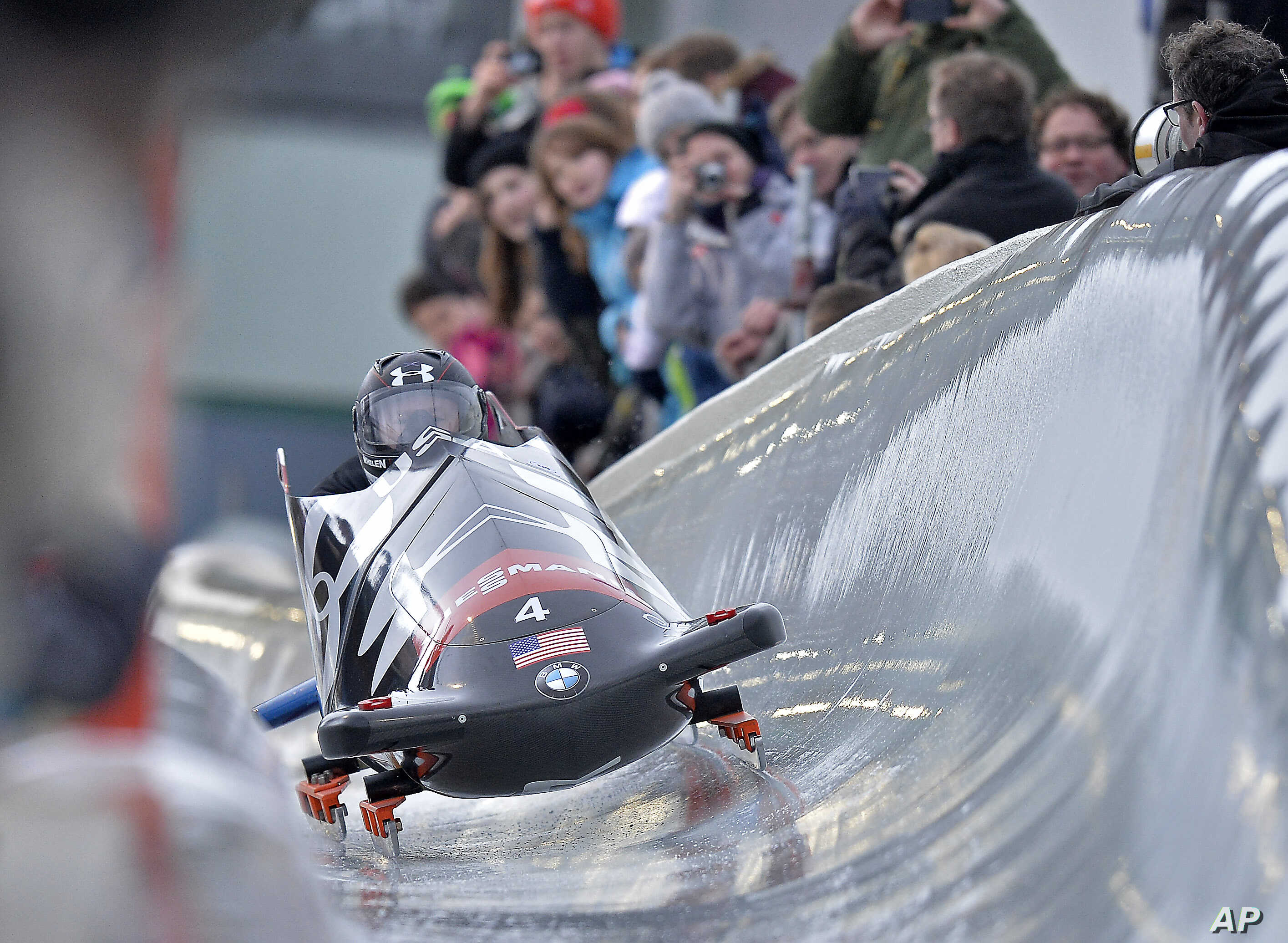Steven Holcomb, front, and Steven Langton from the U.S. speed down the run during the two-man bobsled World Cup in Winterberg, Germany, Jan. 3, 2014.