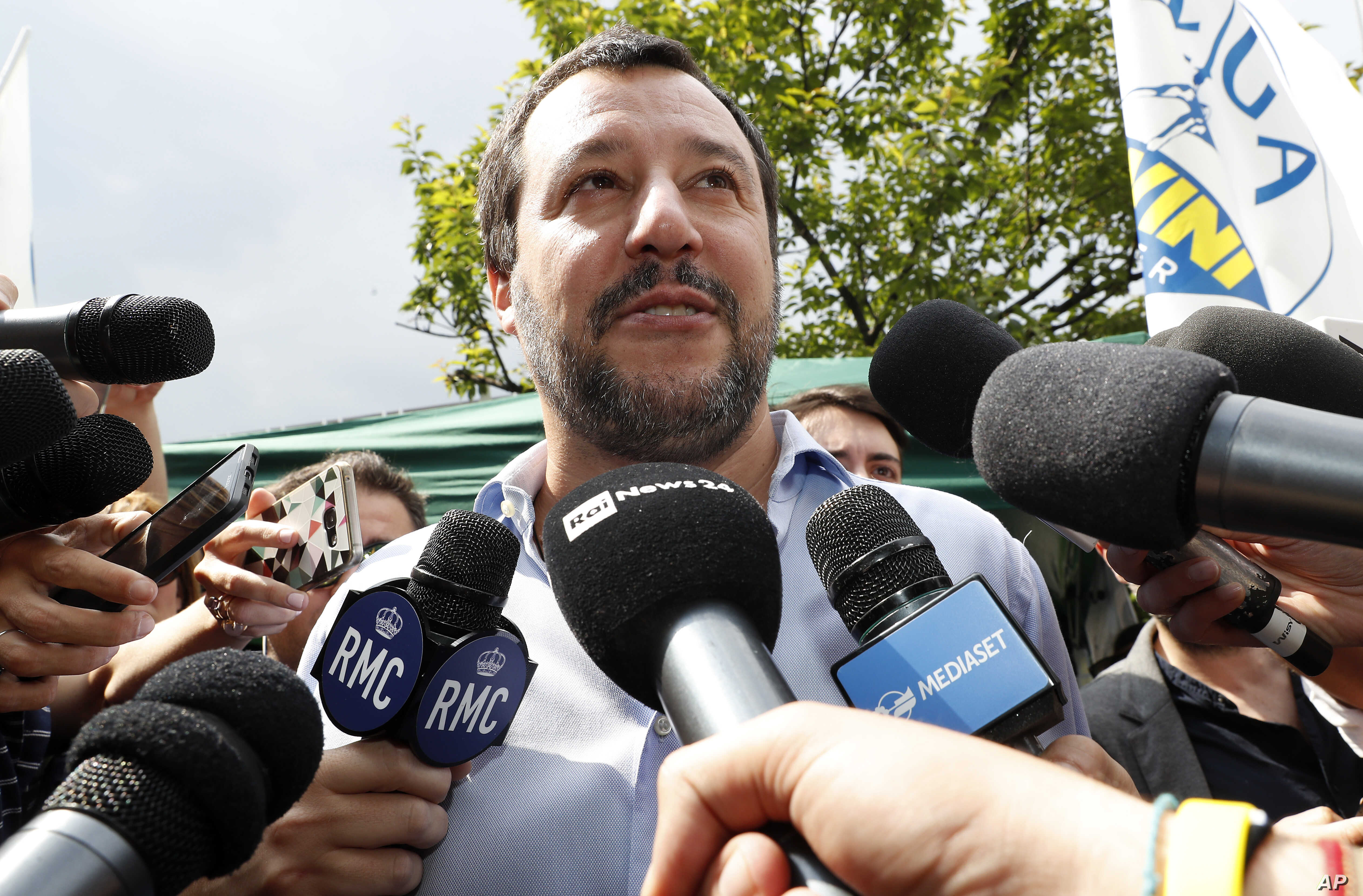 FILE - The League party leader, Matteo Salvini, meets reporters in Milan, Italy, May 19, 2018.