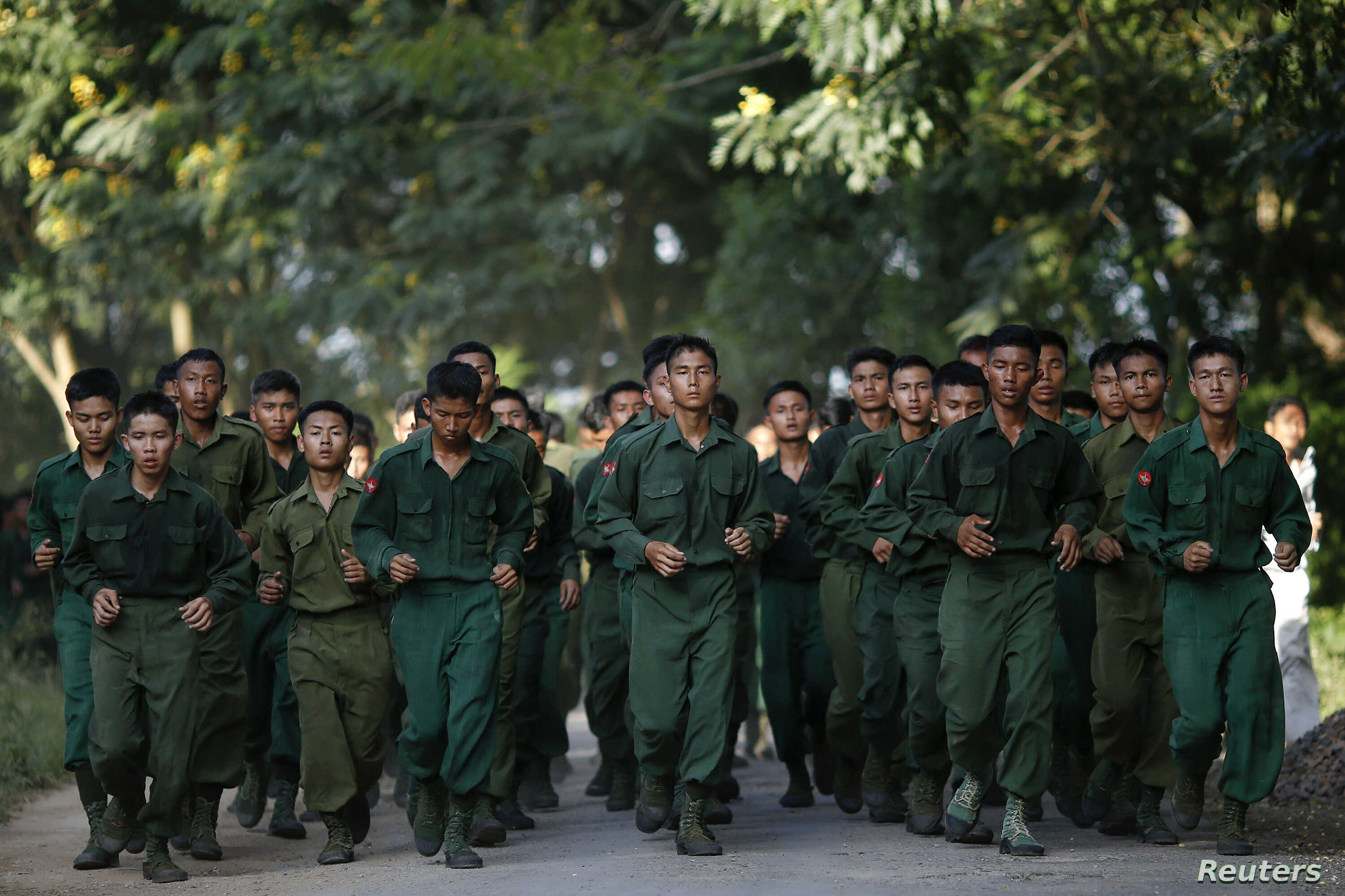 Military cadets of the Defense Services Academy run as they exercise around their compound in Pyin Oo Lwin, Myanmar, Sept. 21, 2012.