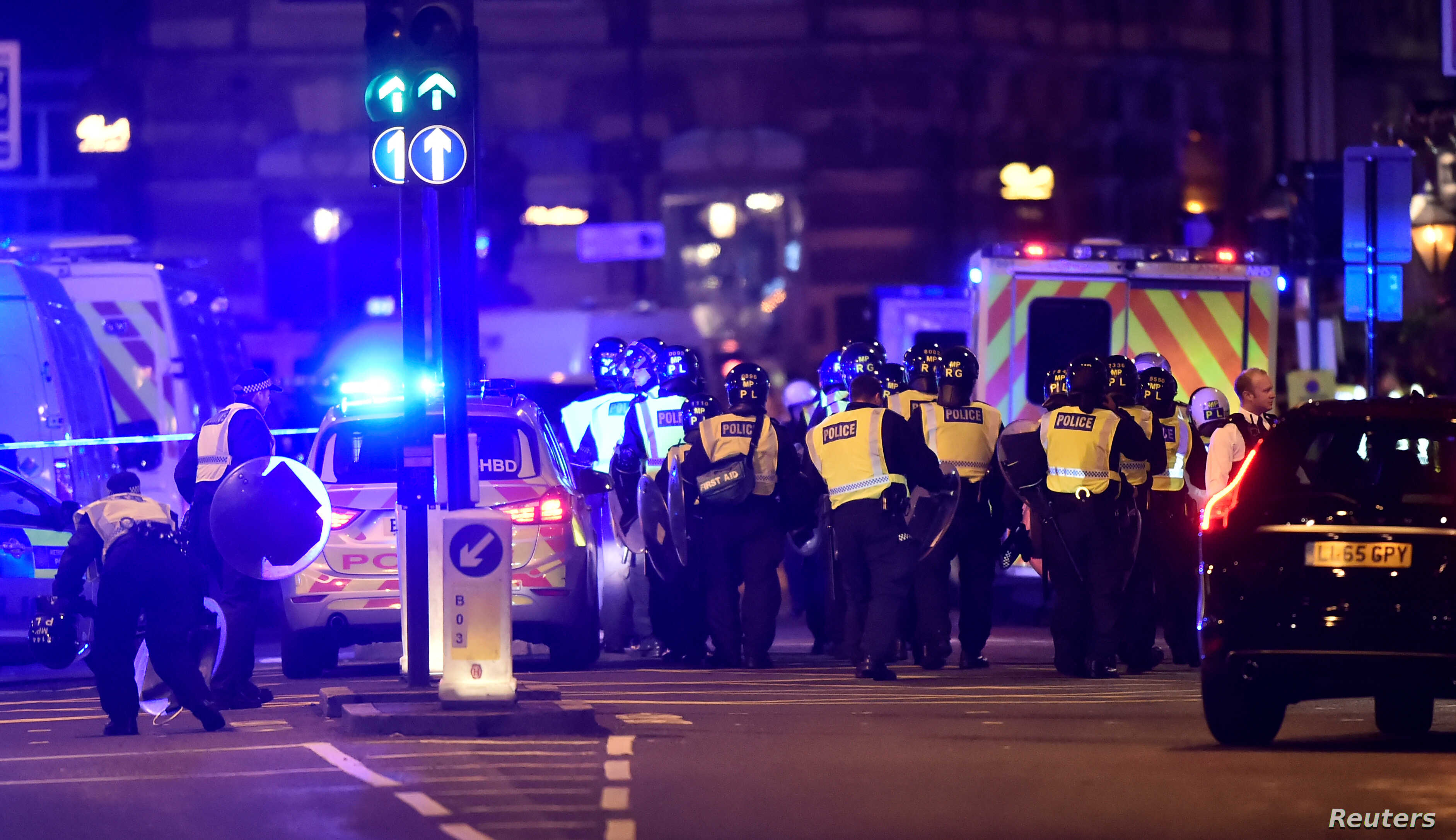 Police attend to an incident on London Bridge in London, Britain, June 3, 2017.