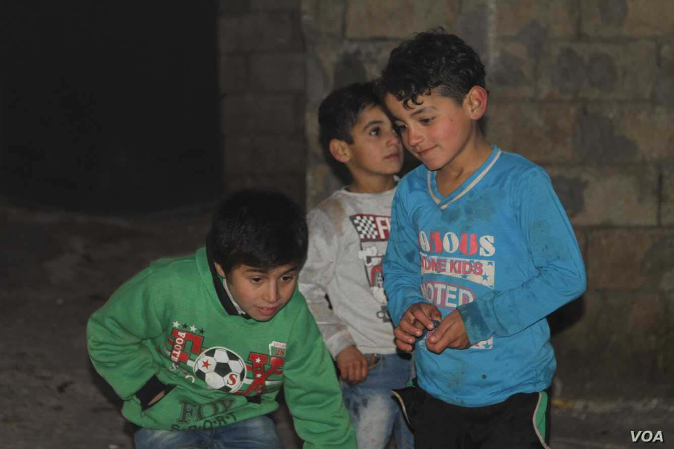 Hoger, in the green shirt, plays with other children in Atmeh refugee camp in northern Syria. Hoger was surrendered to an orphanage in Atmeh several months ago.