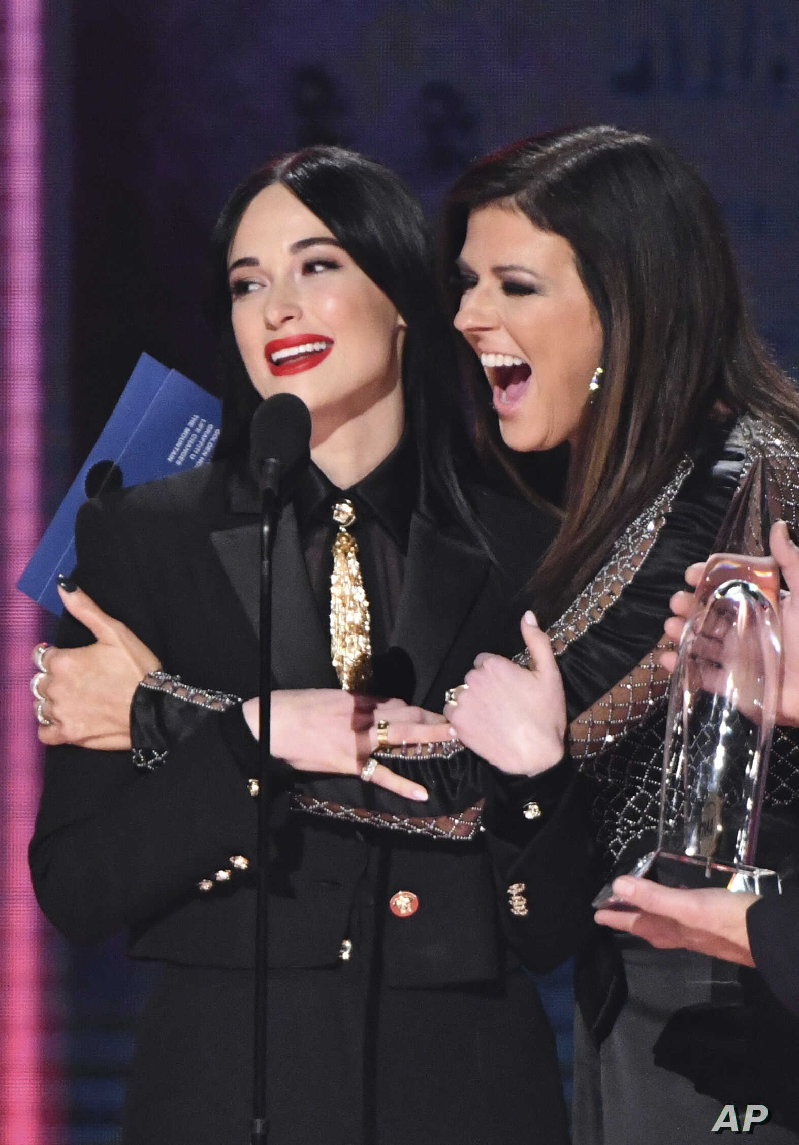 "Karen Fairchild of Little Big Town, right, embraces Kacey Musgraves​, winner of the award for album of the year for ""Golden Hour"" at the 52nd annual CMA Awards at Bridgestone Arena, Nov. 14, 2018, in Nashville, Tenn."