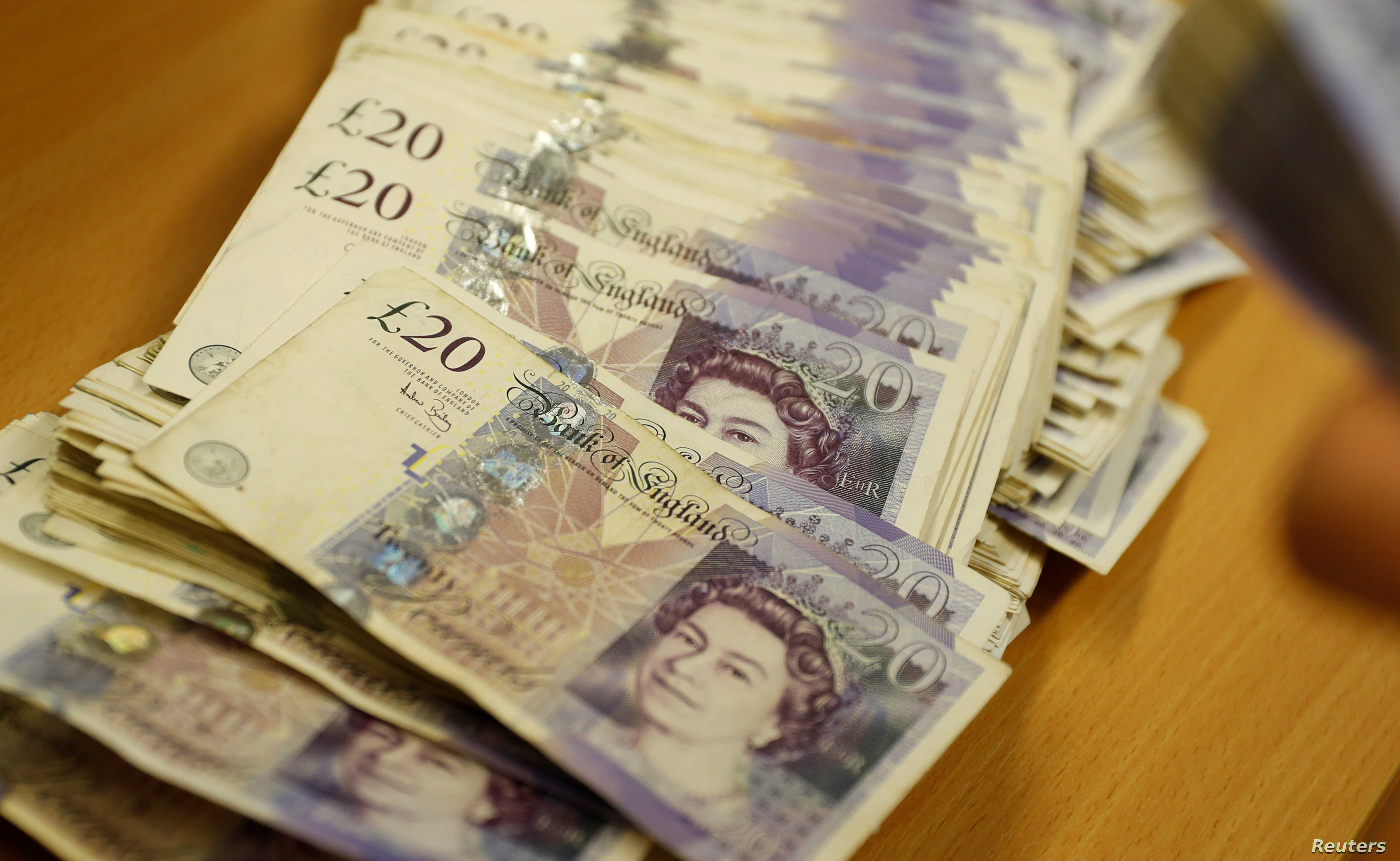 FILE - British Pound Sterling banknotes are seen at the Money Service Austria company's headquarters in Vienna, Austria.