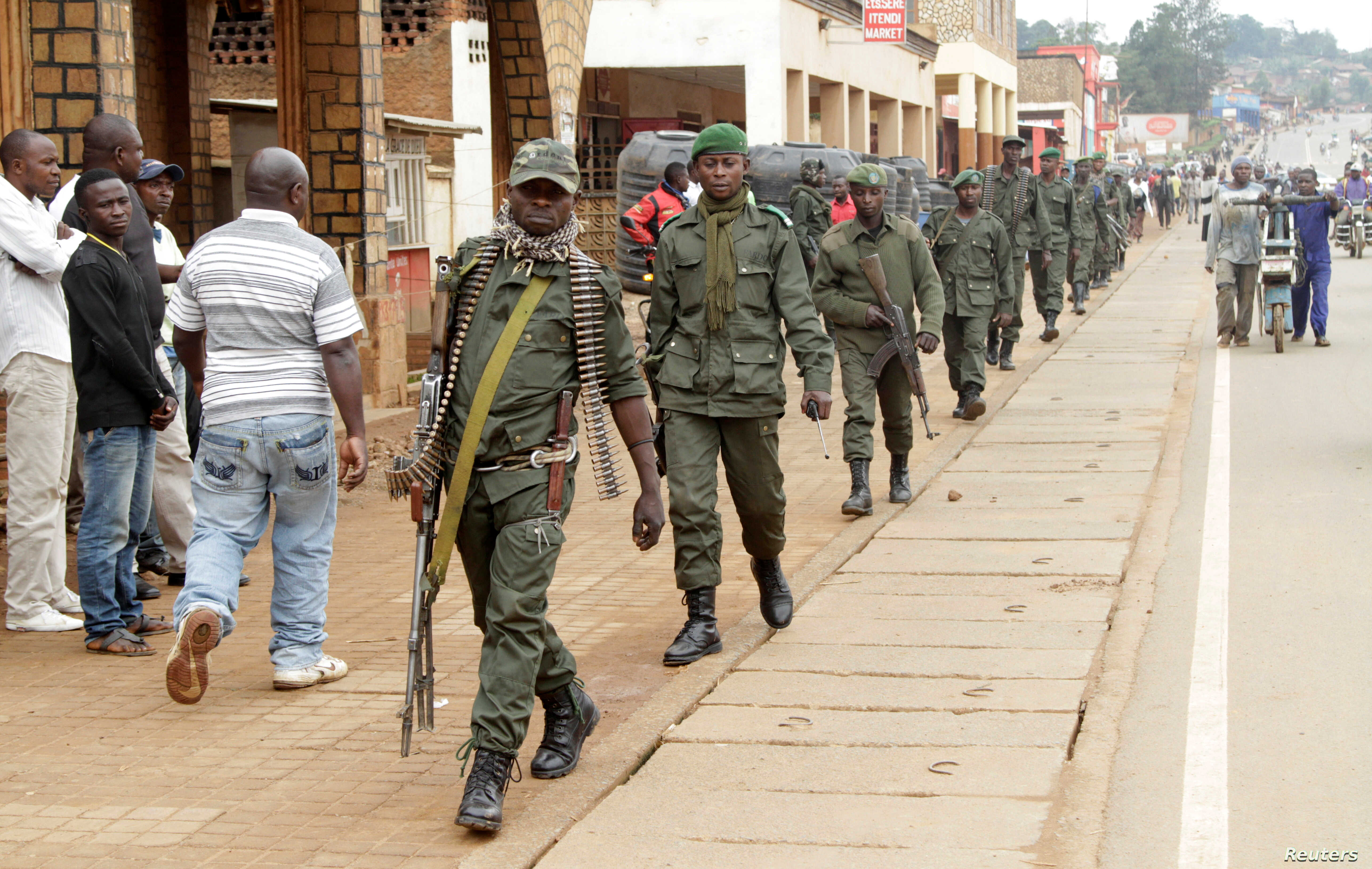 FILE - Congolese soldiers patrol to prevent civilians from protesting against the government's failure to stop the killings and inter-ethnic tensions in the town of Butembo, North Kivu province in the Democratic Republic of Congo, Aug. 25, 2016.