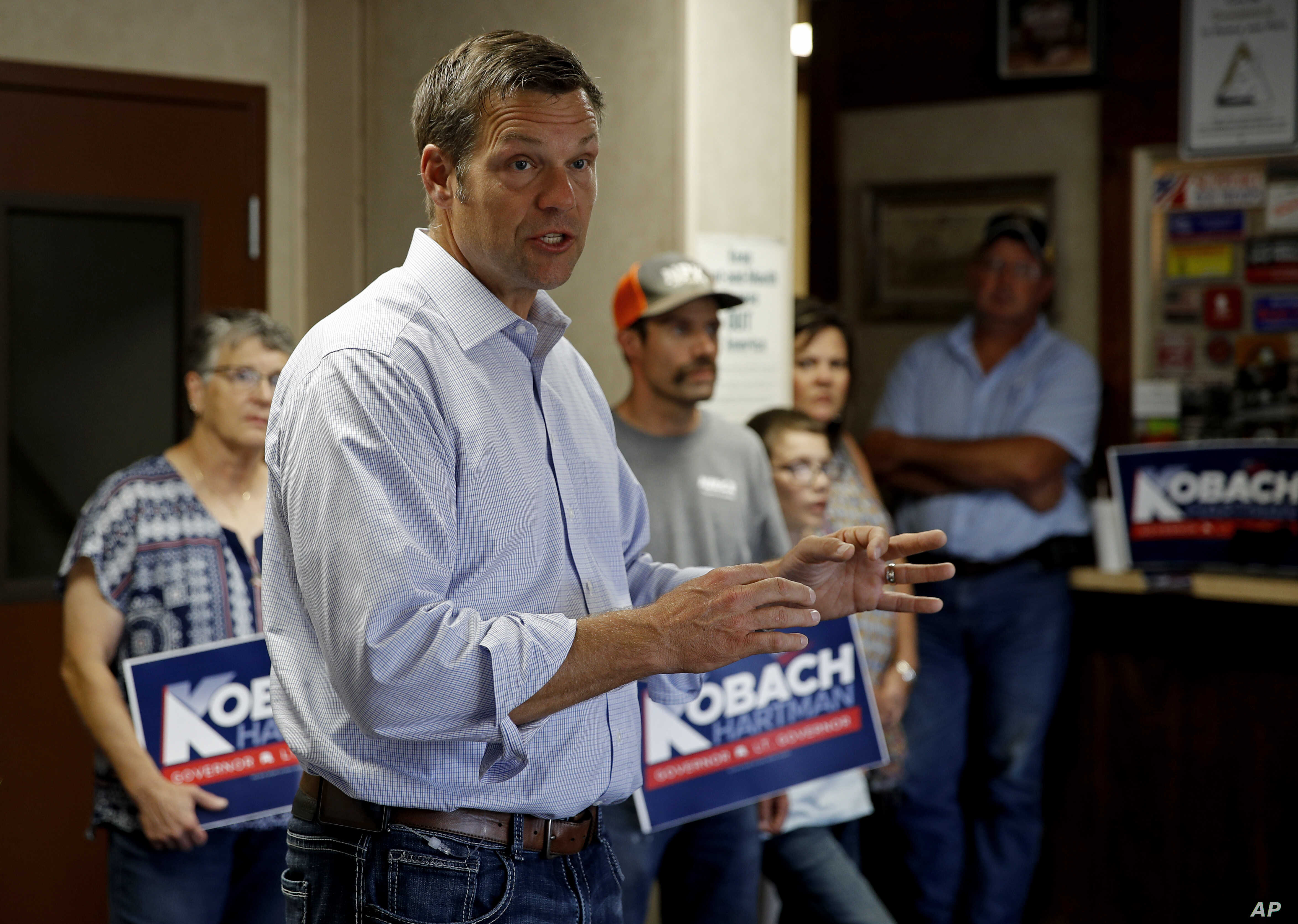 Kansas Secretary of State Kris Kobach and candidate for the Republican nomination for Kansas Governor addresses supporters during a campaign stop, Aug. 3, 2018, at the Fort Scott Livestock Market in Fort Scott, Kan.