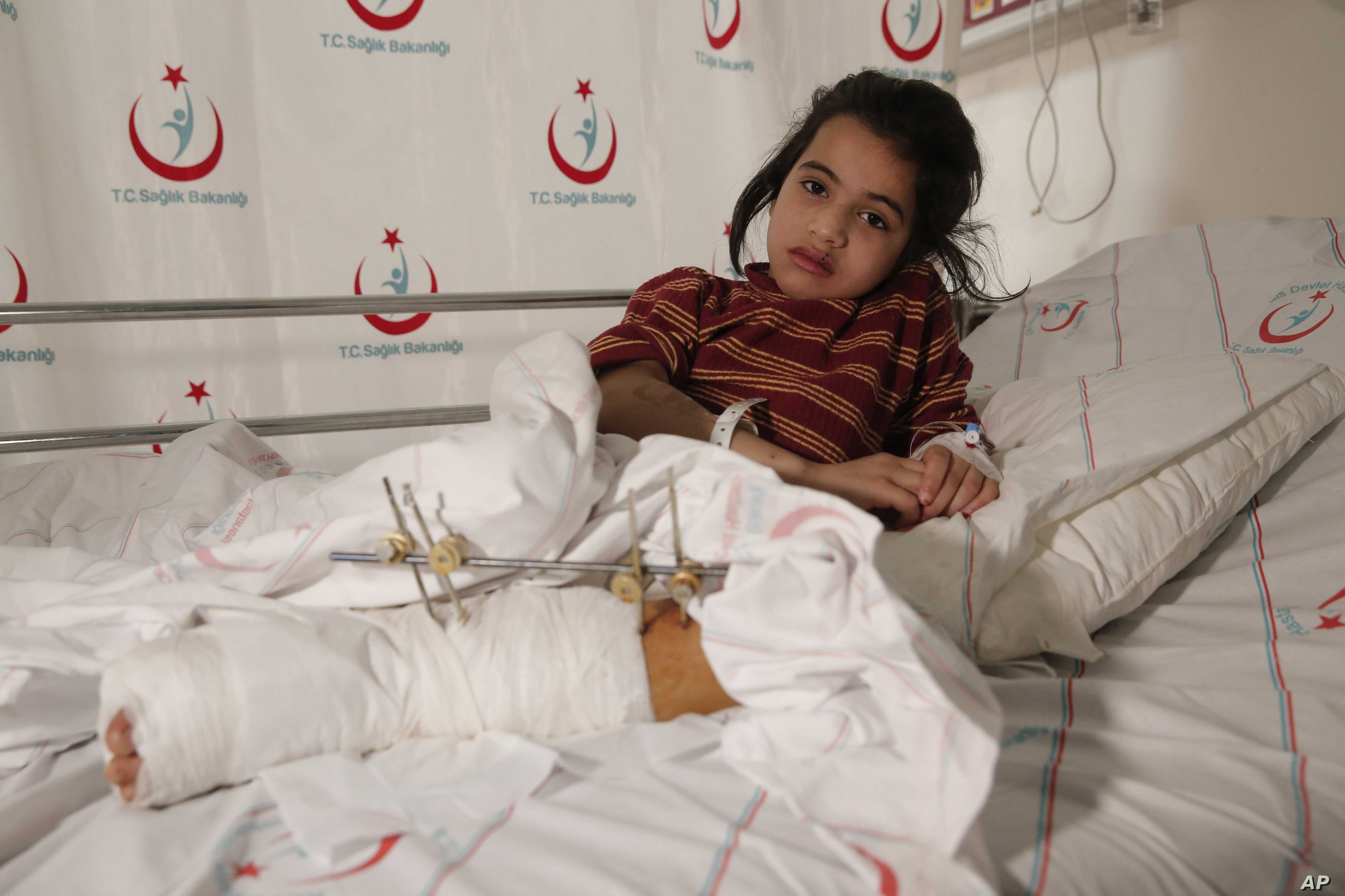 Syrian Aya Sharqawi, 6, wounded in an airstrike 10 days ago in her hometown of Tel Rifaat, Syria, lays on her bed at a hospital in Kilis, Turkey, Feb. 9, 2016.