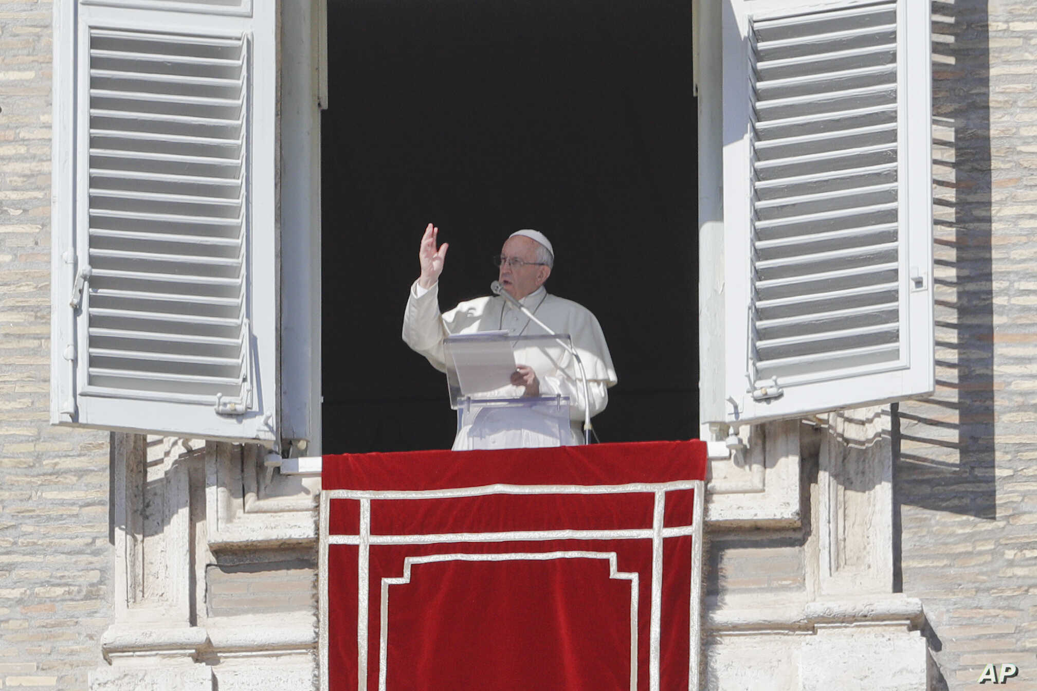 Pope Francis delivers a blessing from his studio window overlooking St. Peter's Square on the occasion of the Angelus noon prayer at the Vatican, Feb. 4, 2018.