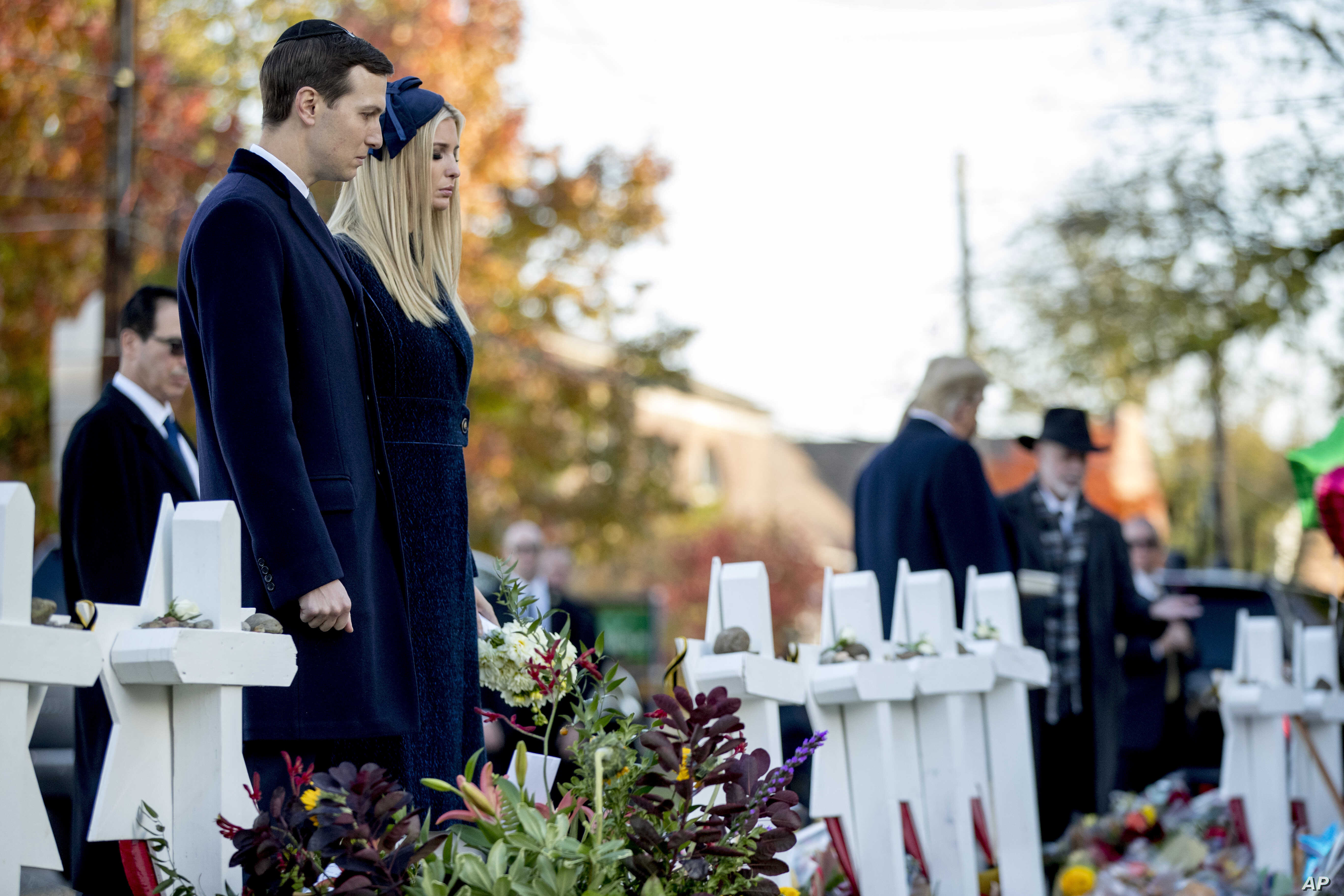 President Donald Trump's White House senior adviser Jared Kushner and Ivanka Trump, the daughter of President Donald Trump, second from left, stand at a memorial for those killed at the Tree of Life Synagogue in Pittsburgh, Oct. 30, 2018.