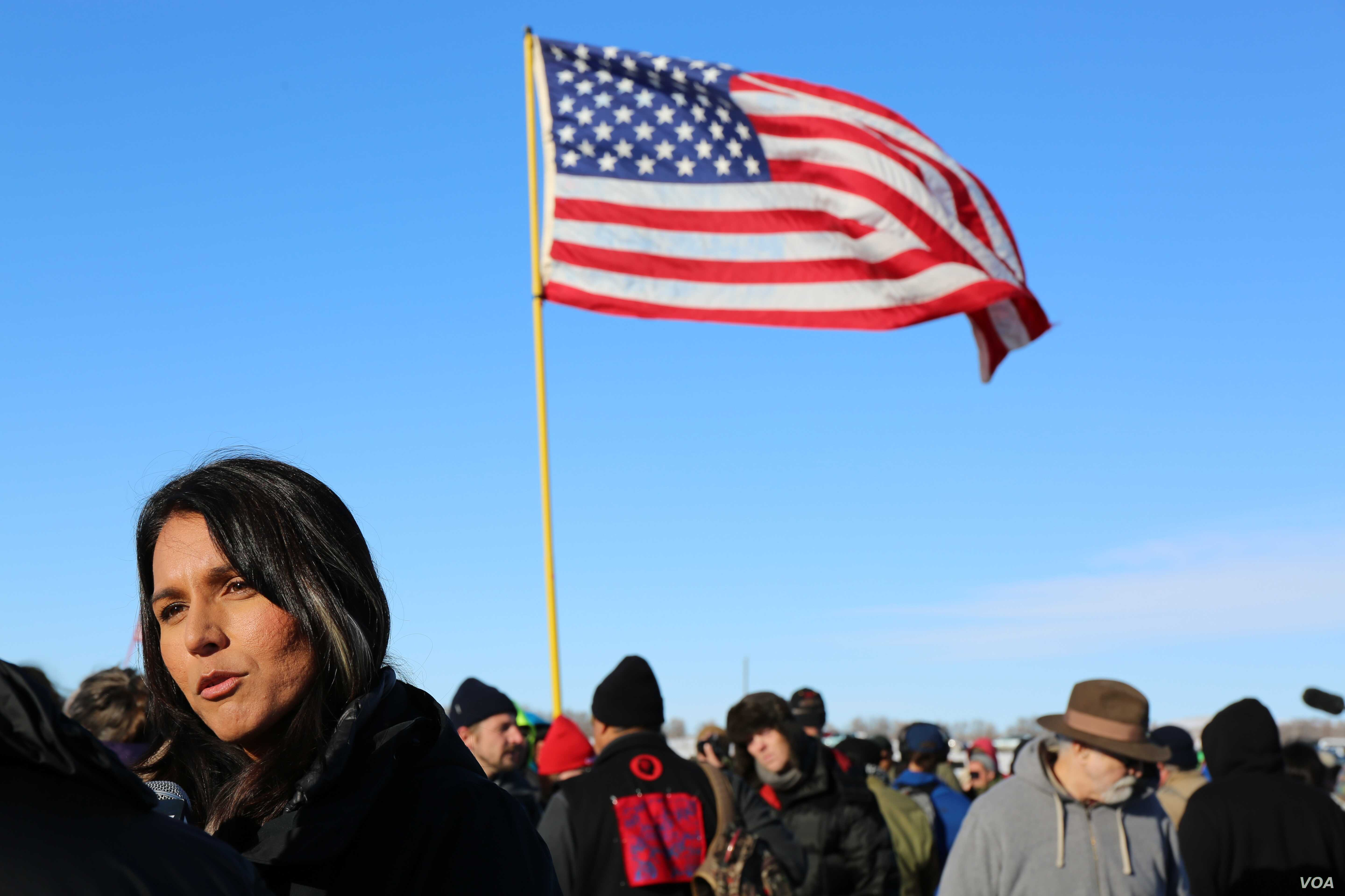 Hawaii Congresswoman Tulsi Gabbard speaks to the media after addressing veterans near the Standing Rock camp in North Dakota (E. Sarai/VOA)