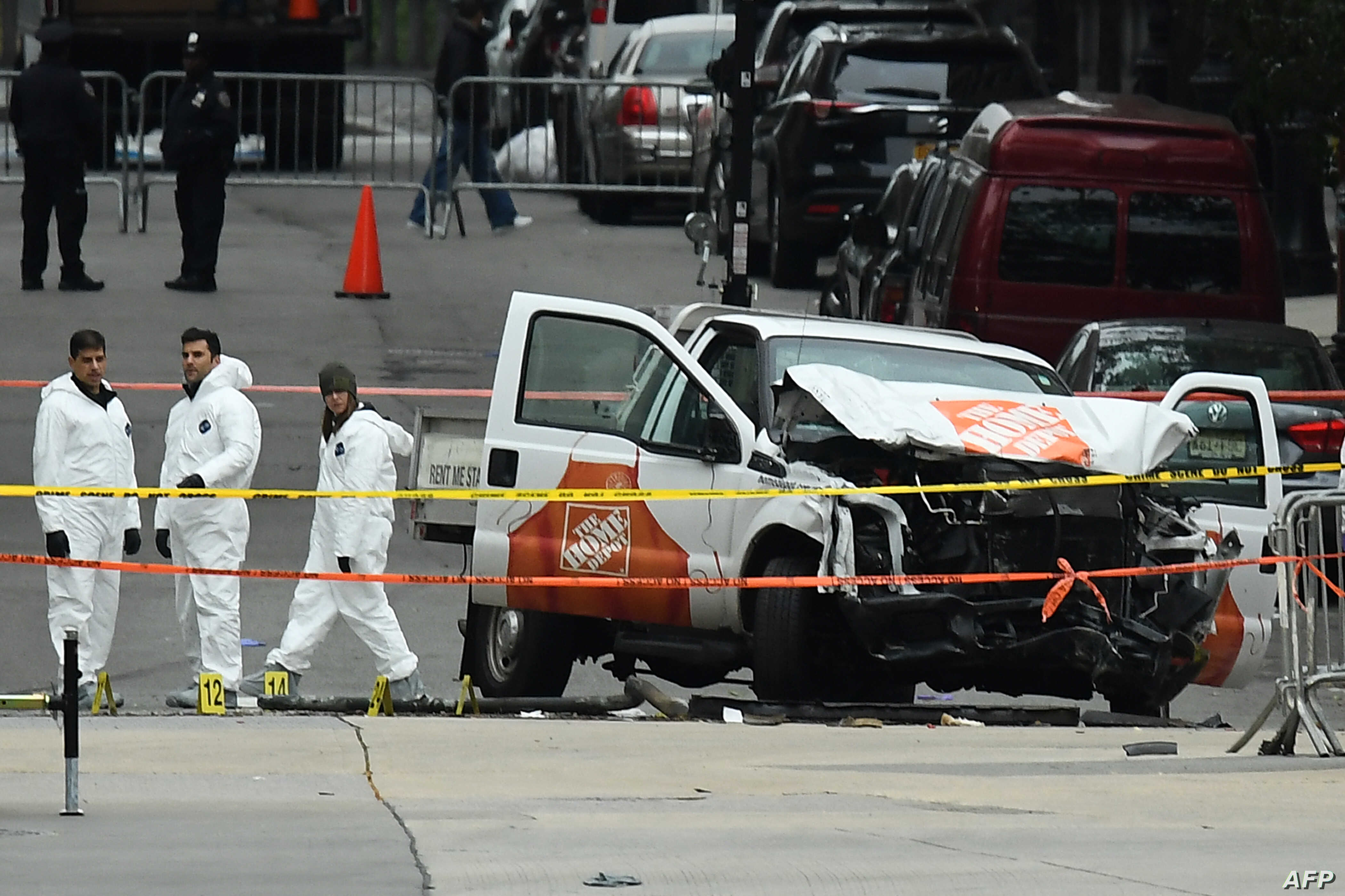 Investigators work around the wreckage of a Home Depot pickup truck a day after it was used in a terror attack in New York on Nov. 1, 2017.